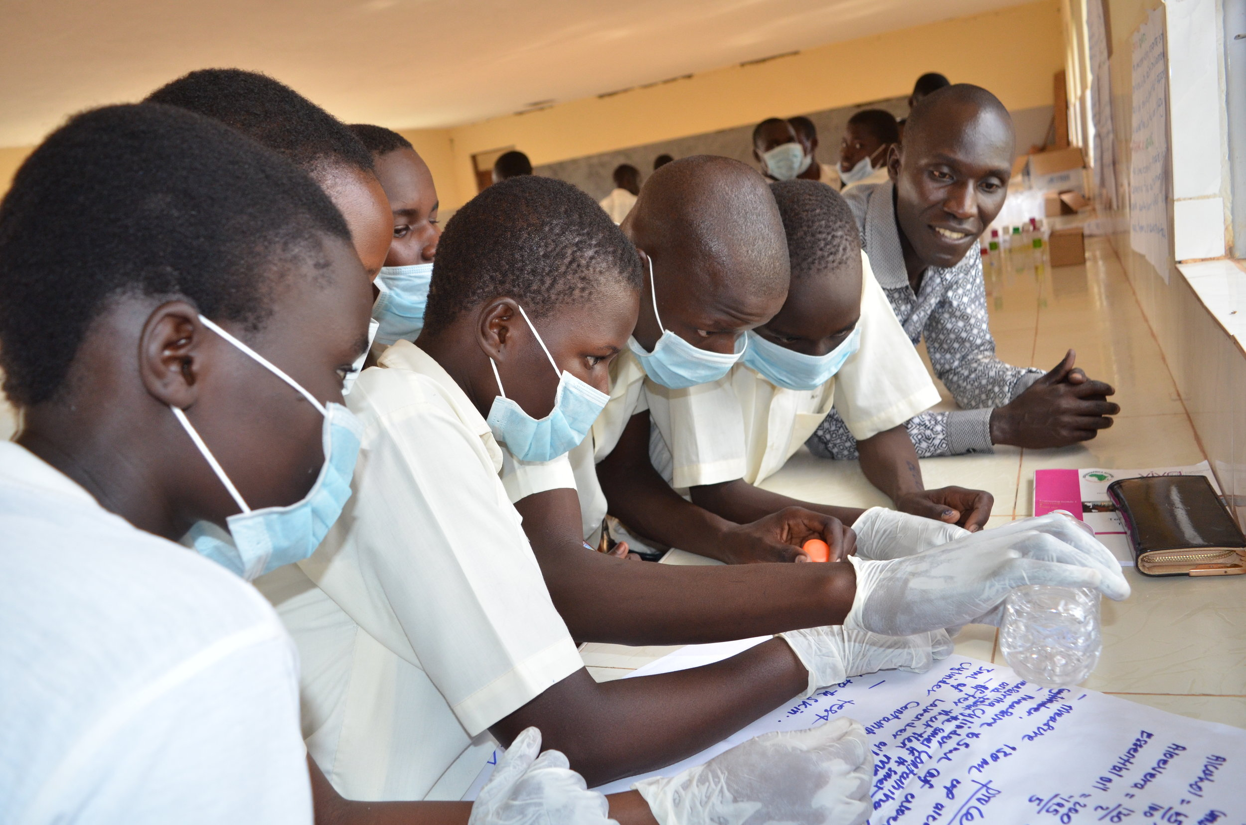 Copy of Students creating their first prototype of a locally made hand sanitizer.JPG