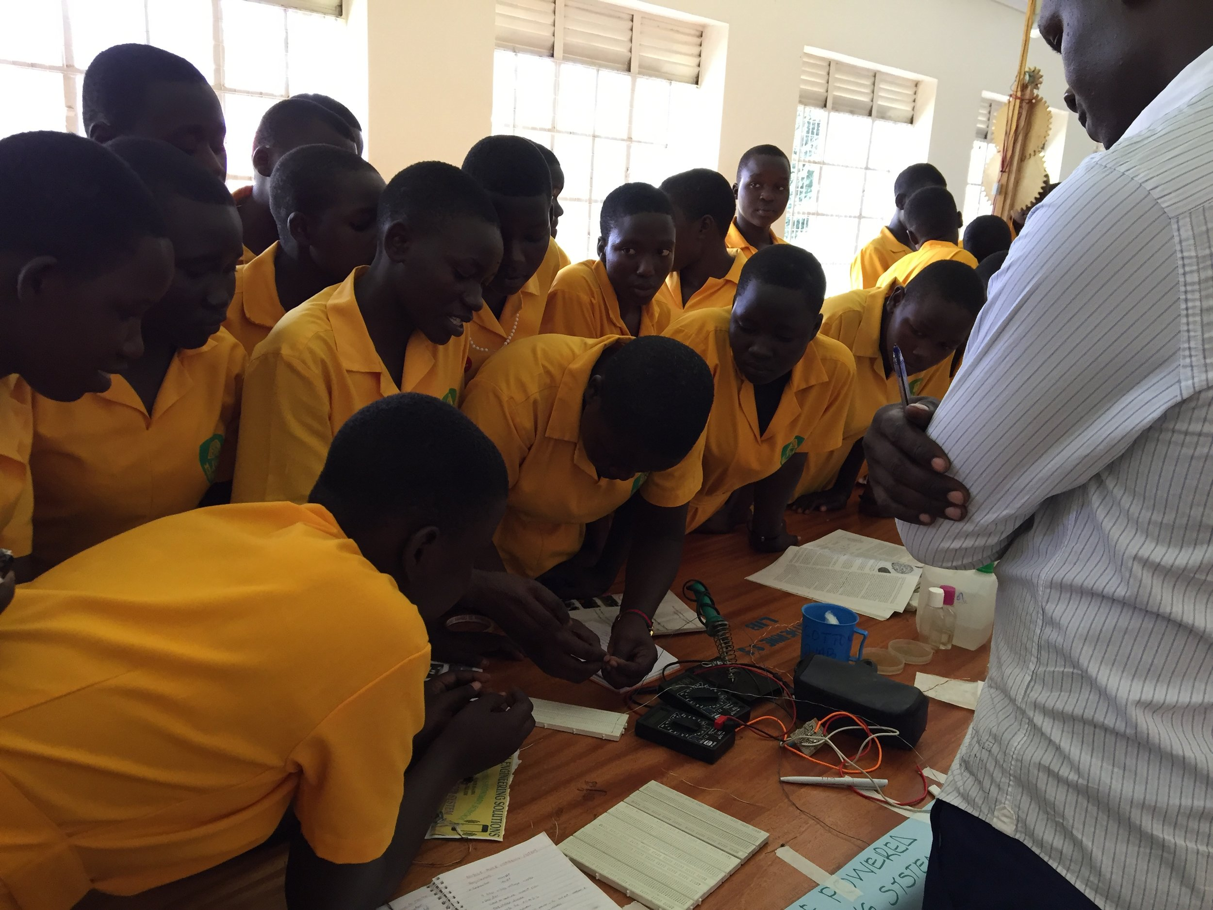 ST. Katherine girls s.s show a judge how to make a bike powered phone charger (1).JPG