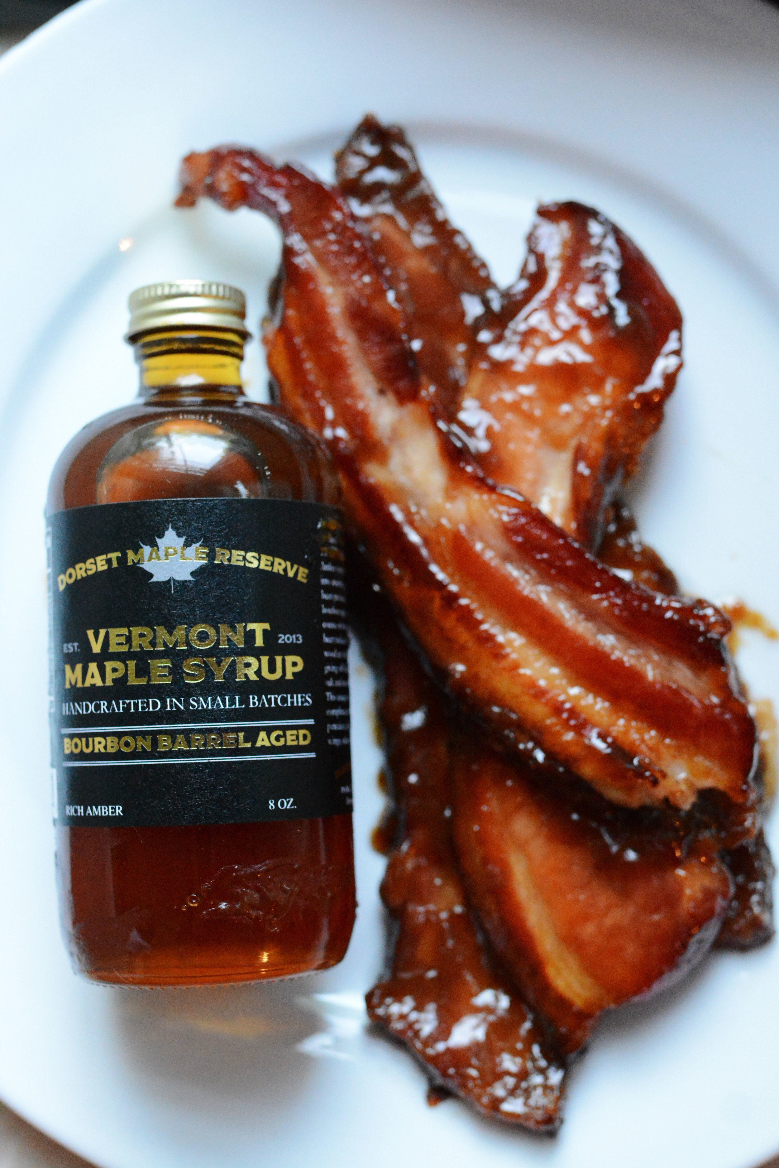 Maple Candied Bacon - 1 lb good quality bacon2 tbsp rich amber maple syrup1/4 cup brown sugar2 tsp dijon mustard1/2 tsp kosher salt 1/4 tsp cayenne pepperPreheat oven to 350 degrees.Wrap baking sheet with tin foil and top with wire rack.In a bowl add all ingredients and mix well, add bacon and coat evenly with mixture.Place bacon in a single layer onto wire rack. Bake for 30-35 minutes. Remove from oven and let cool for 5 minutes (don't let them sit for too long or they will stick.