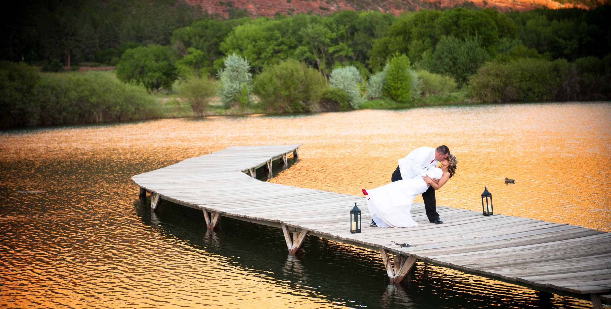 Our wooden dock stretches onto a private 5-acre lake. Sunsets are a sight to behold.  Photo courtesy of Allison Ragsdale Photography.