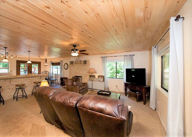 Cabin - Our 3 bed/2 bath cabin is 1500 sqft. and sleeps six comfortably. Beds include a king, queen, and twin bunks. Also included is a 20x20 covered deck with wood stove.