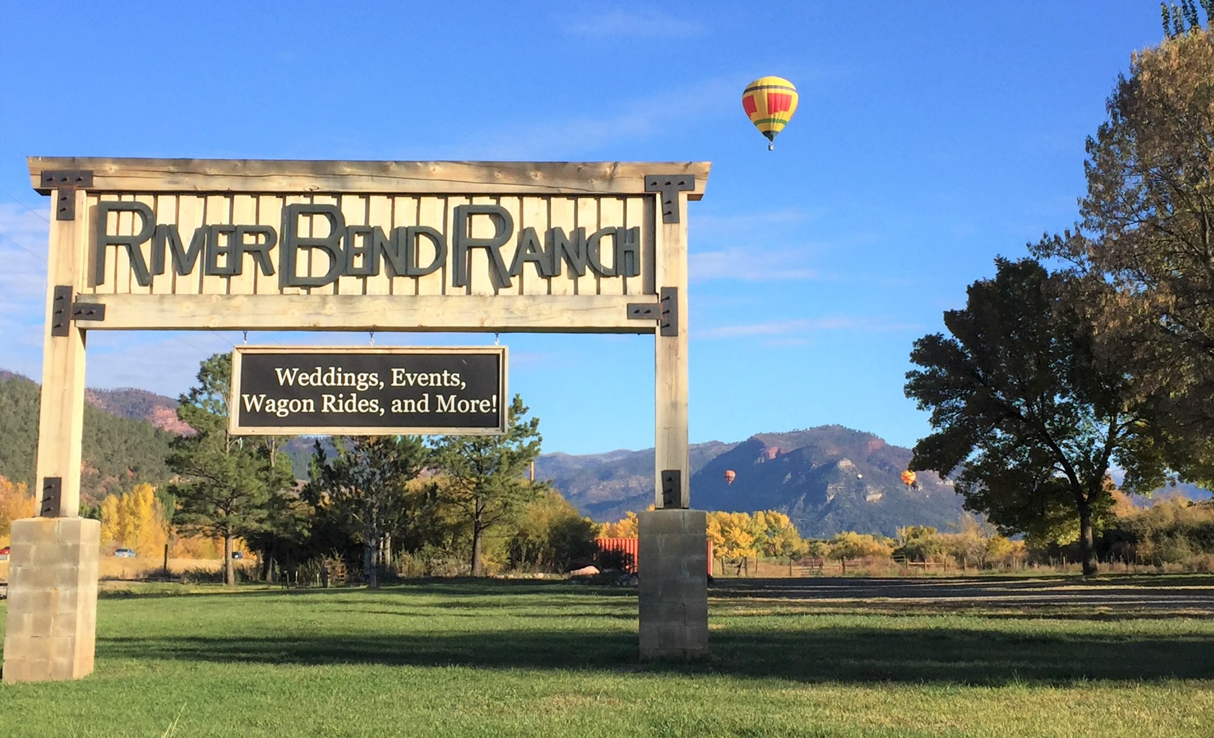 We're for Special Events - River Bend Ranch is a privately-owned ranch nestled in the beautiful Animas Valley just a few miles north of Durango, Colorado. We operate as a wedding and event venue all year long with our rustic event center.Several times a year, we get to enjoy a scene like this, with hot air balloons scattered across the sky. It's not uncommon to have a balloon land on the property and we enjoy it every time they touch down.