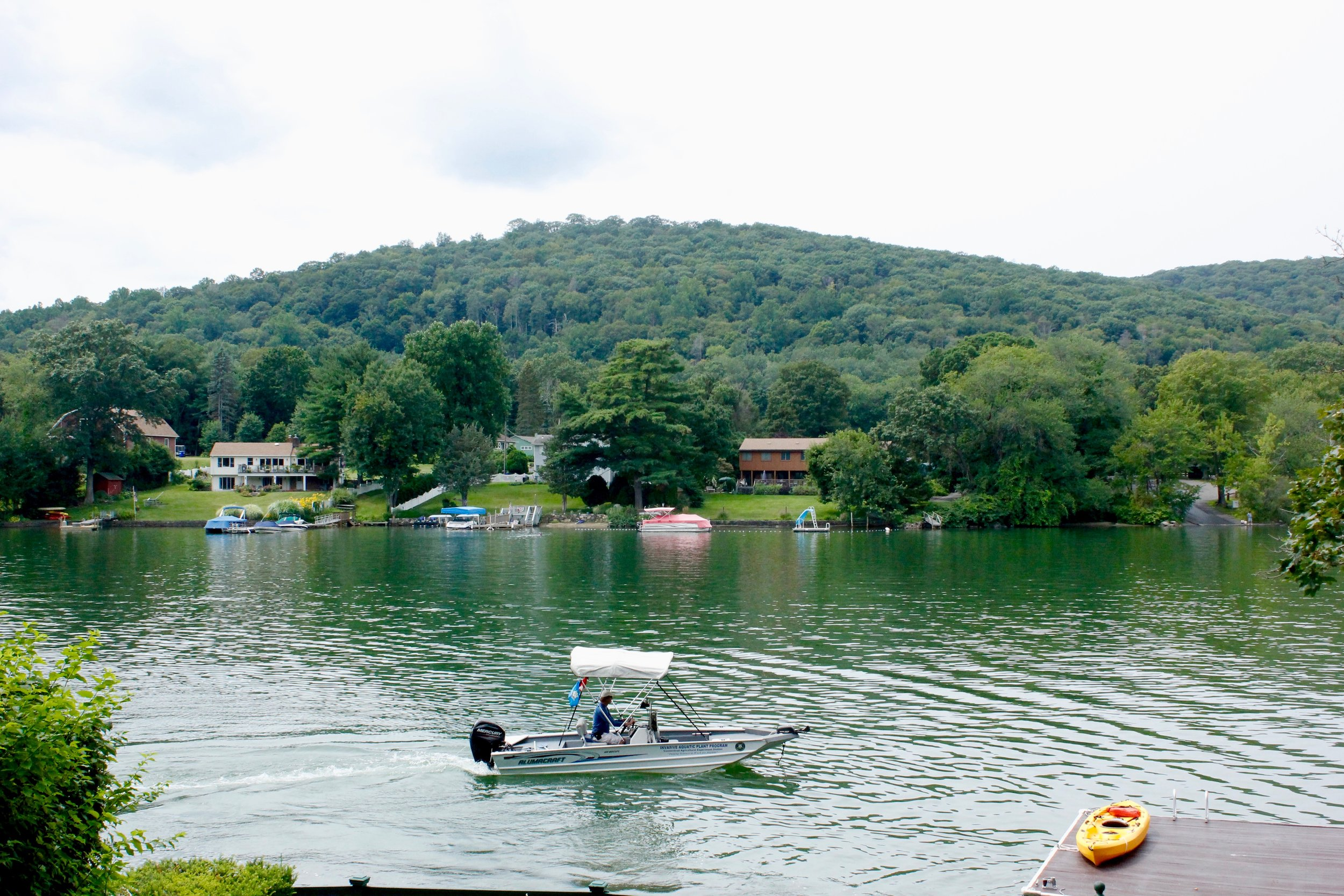 Candlewood Lake, where people boat & play, serves as a form of energy storage where water sits until it's needed to produce electricity.