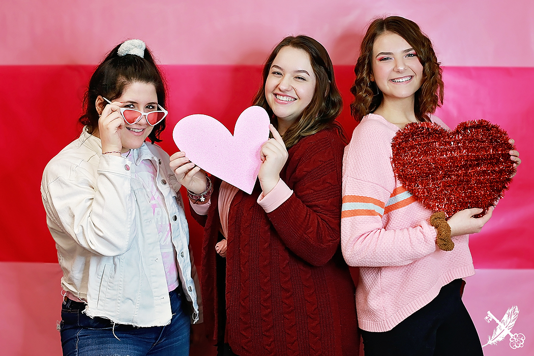 Norwell and Central Noble seniors with heart props at the feather and key studio in huntington indiana