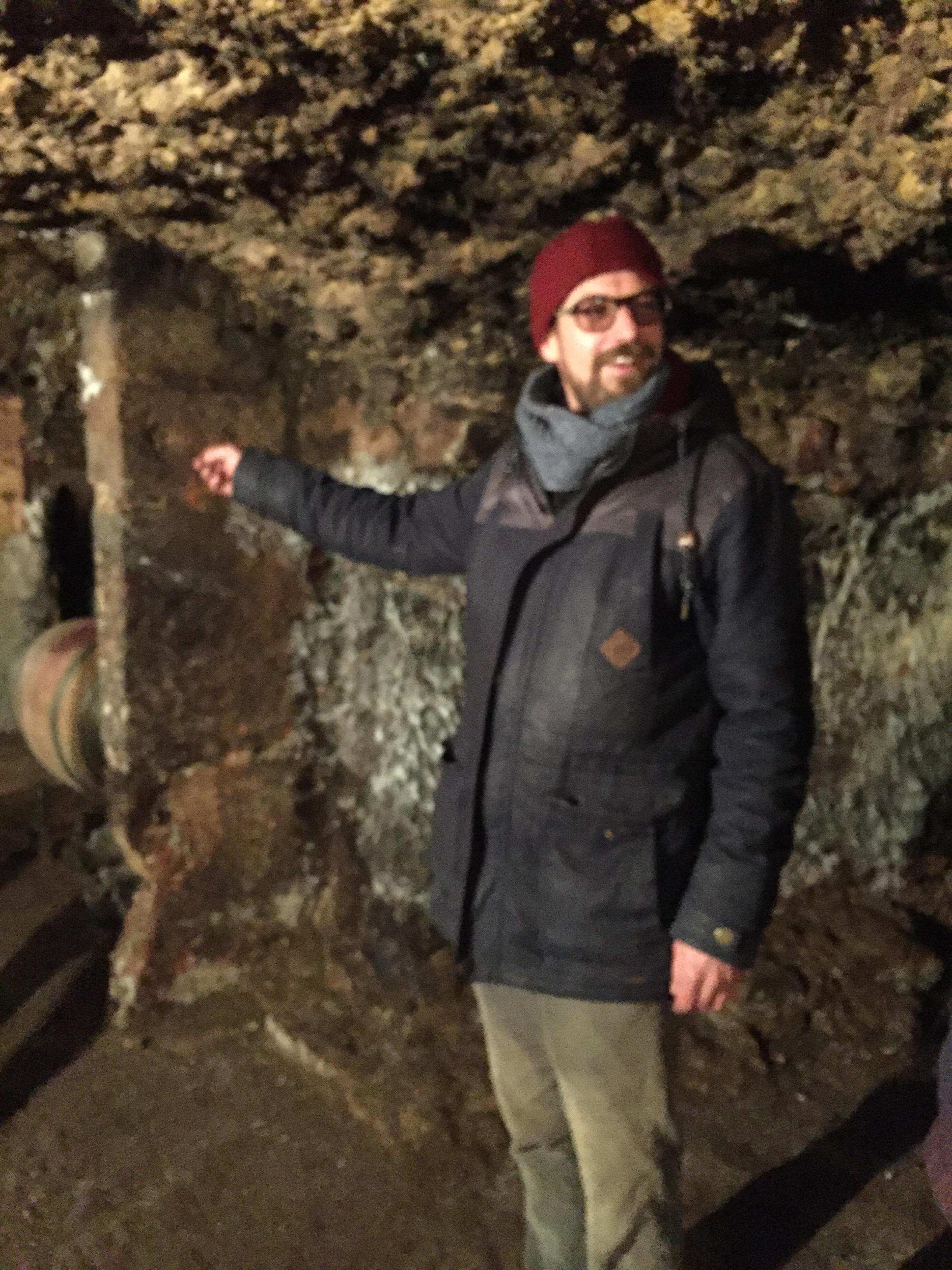 Sylvain in his cellar.JPG