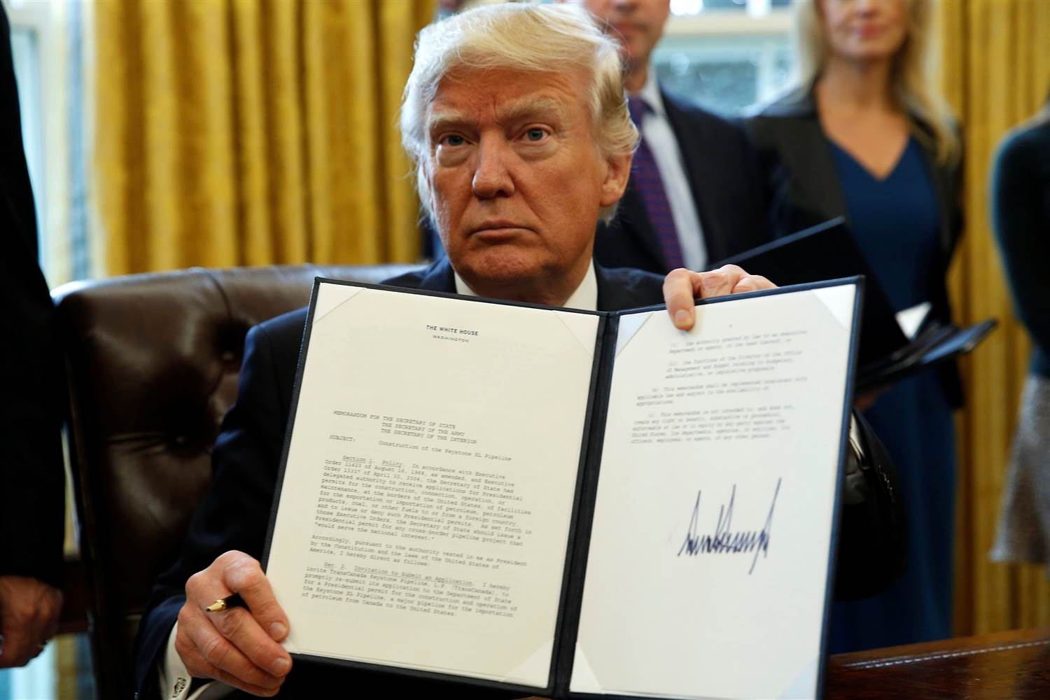 Trump after signing the order, photo via  NBC News