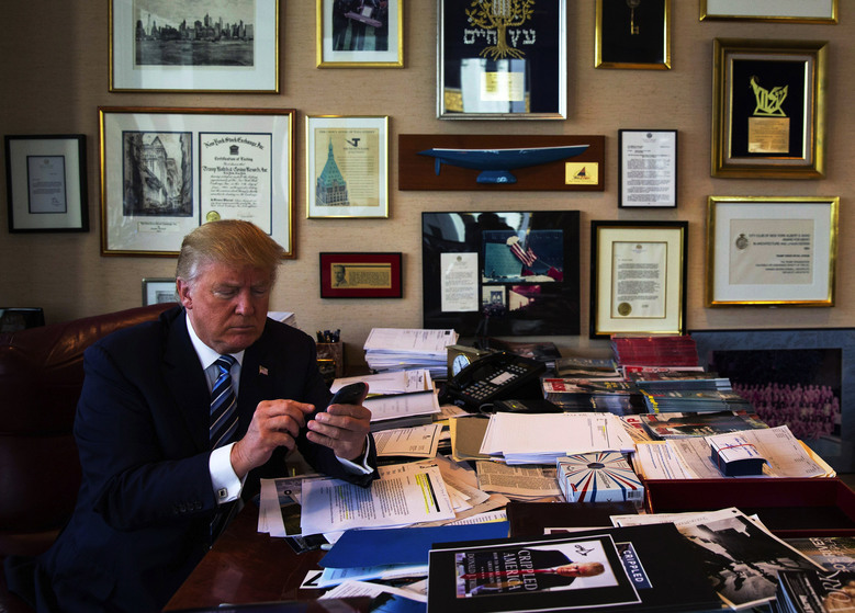 Trump on his phone, photo via  unknown