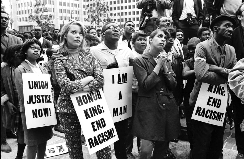 protestors honoring King, photo via  Getty Images