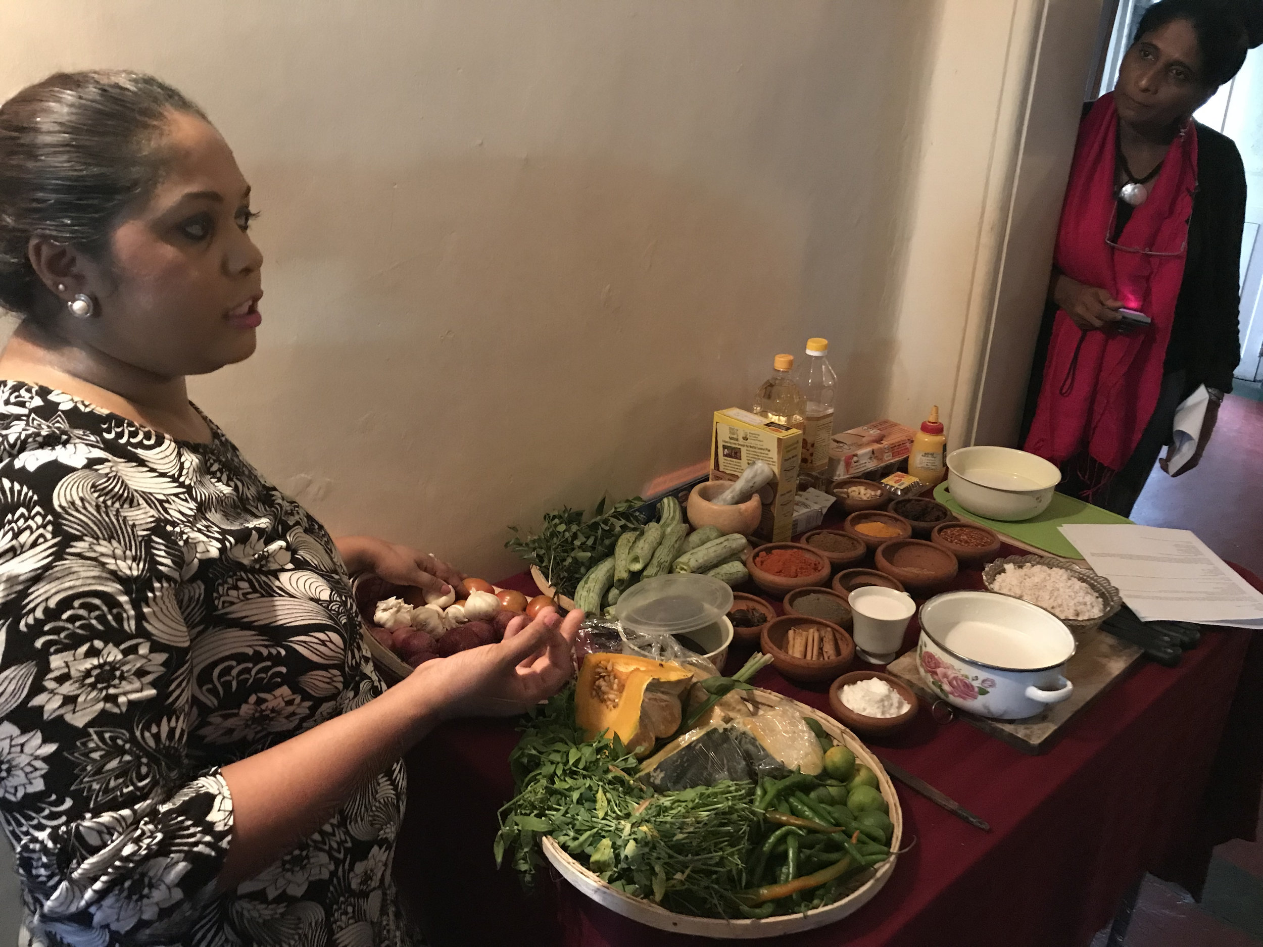 The beginning: Duneeshya explains some of the ingredients we'll be using to prepare our traditional Sri Lankan feast (as US-SLFC Executive Director Sandarshi looks on).