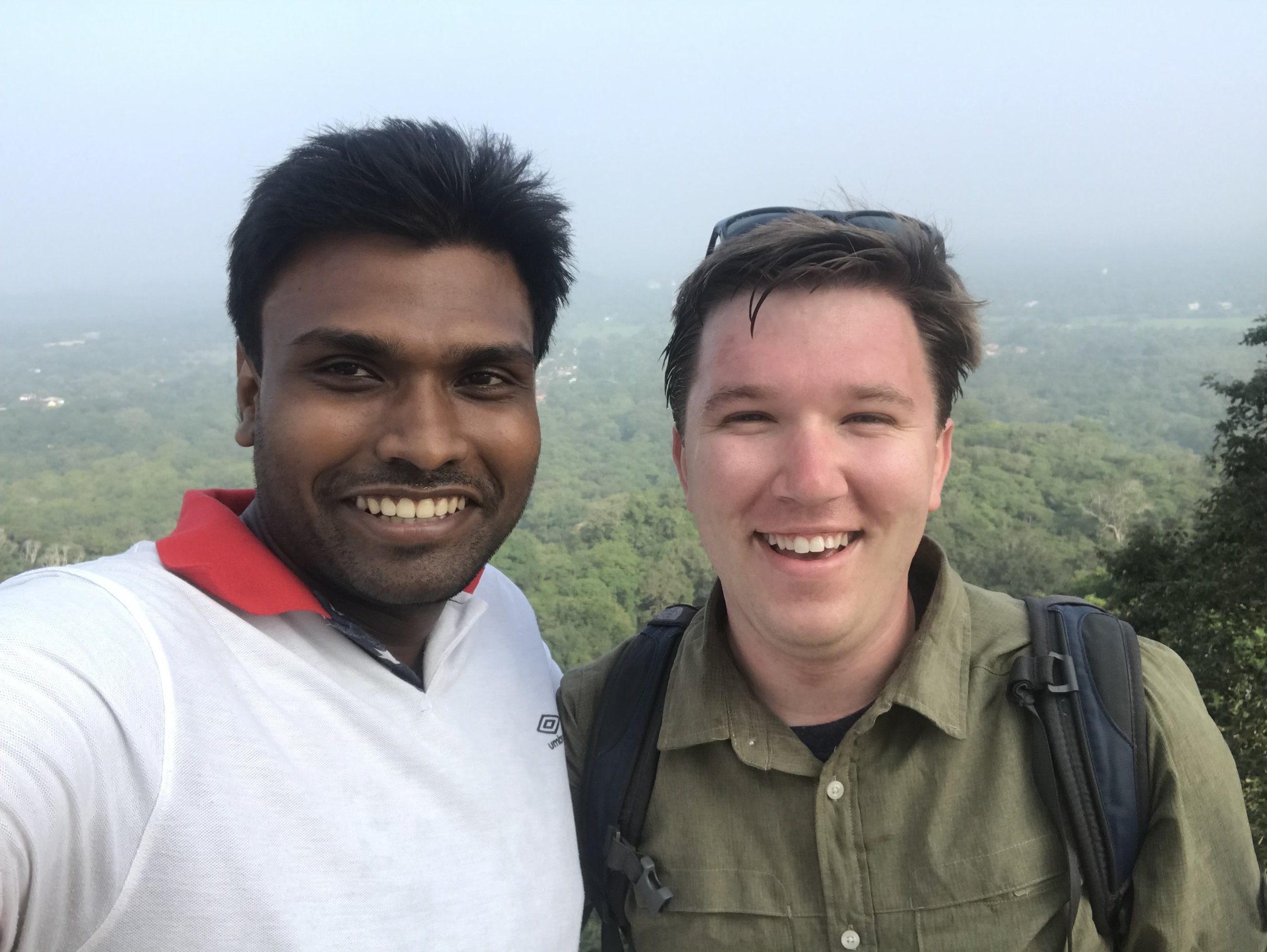 A selfie of Thilina and I atop the Maha Stupa. My sweat shows that I still haven't acclimated to Sri Lanka's heat and humidity. Maybe by the time I leave, I will.