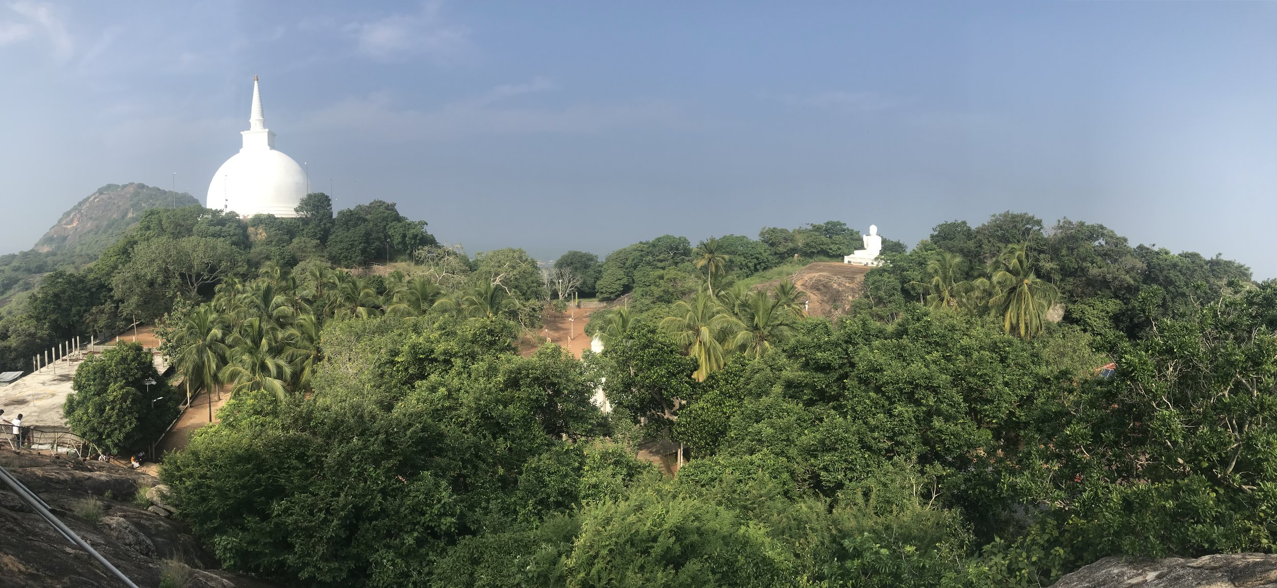 The view from the top of Aradhana Gala. The Maha Stupa is to the left, and the Buddha statue is to the right. The Ambasthala Dagaba is the bit of white down there in the middle, covered by trees.