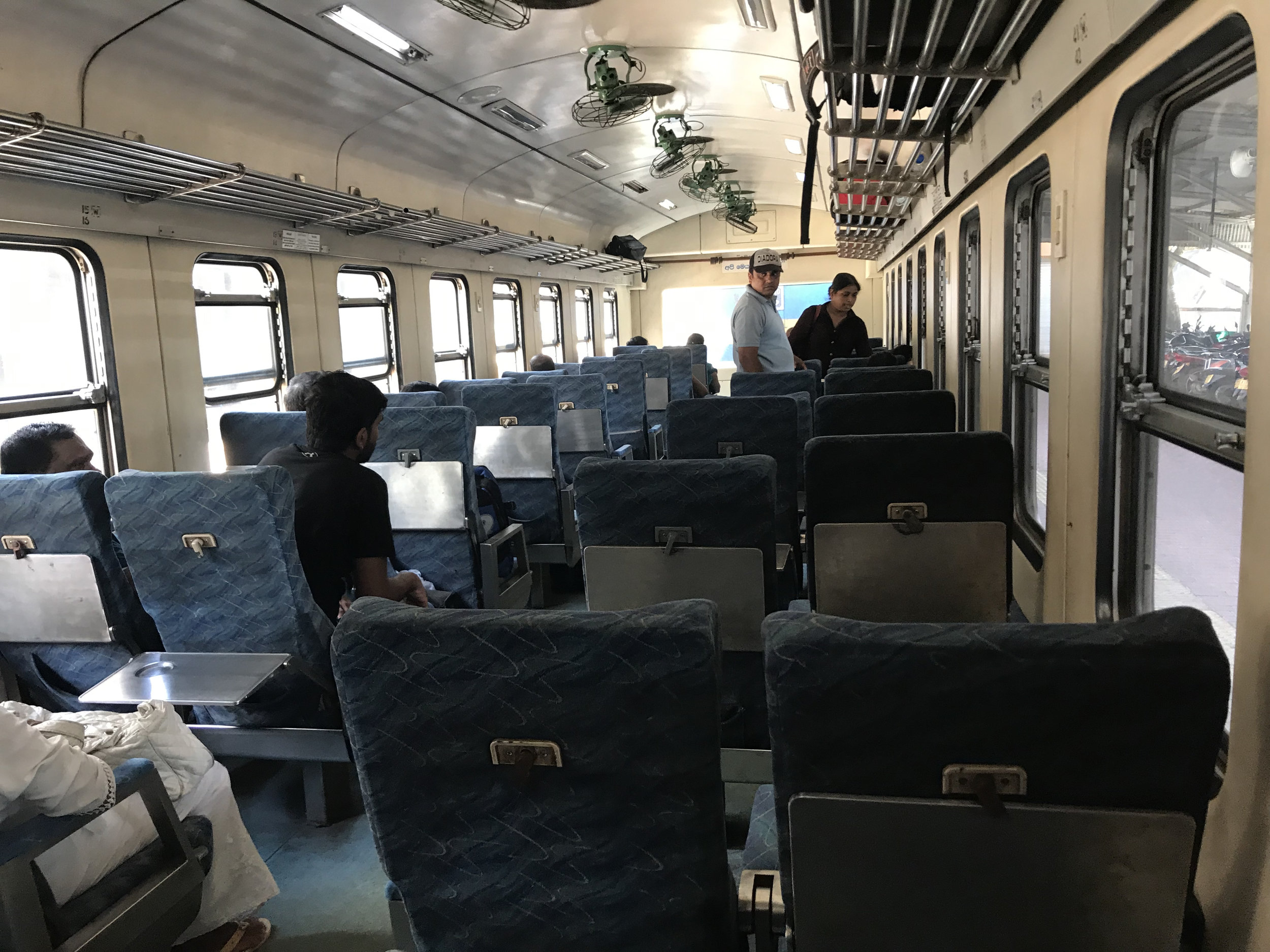 A view from my seat on the train to Colombo. In one of the first-class cabins, there's much more leg room than on a typical passenger plane. Fans above help cool down the space, but virtually every window was open on the journey.