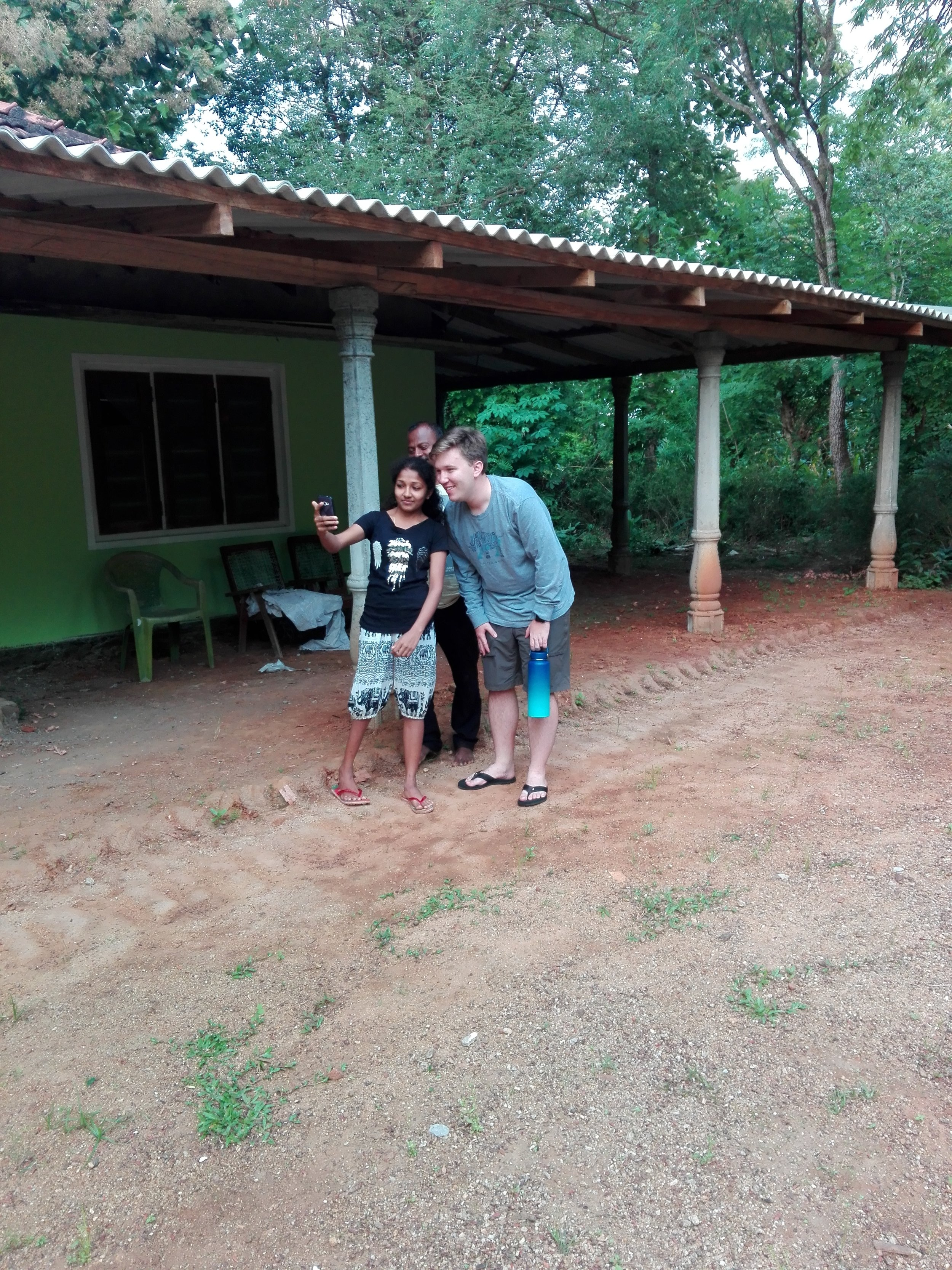 I pose for a selfie with a girl from Nimal's village. Nimal is also posing for the photo…he never passes up an opportunity for that. Note: Sachintha took this photo with the intent of posting it on social media to embarrass me. I figure that if I do it first, I take away his power to do that. Photo: Sachintha Samaraweera.