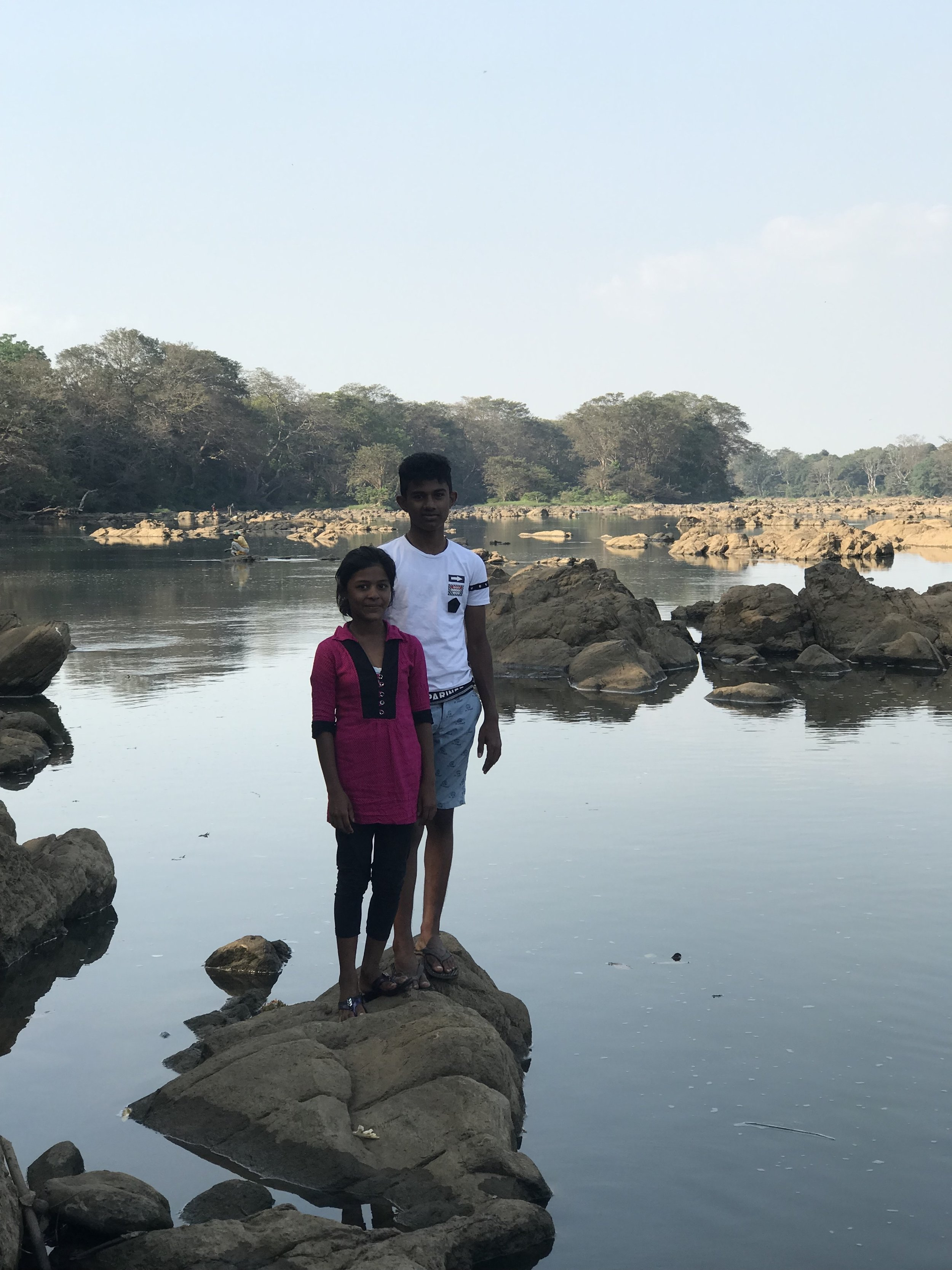 Siblings Moksha and Nimesh by the river where we stayed in the Wasgamuwa bungalow.