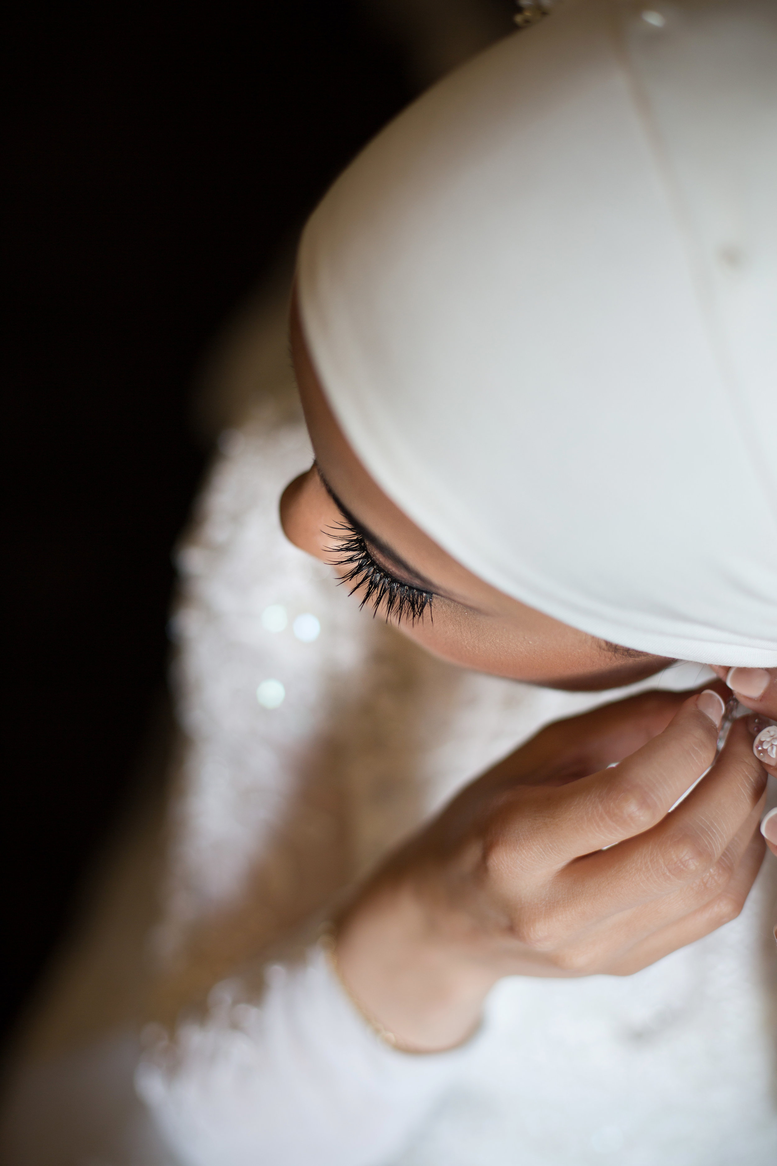 Bride fixing her earring