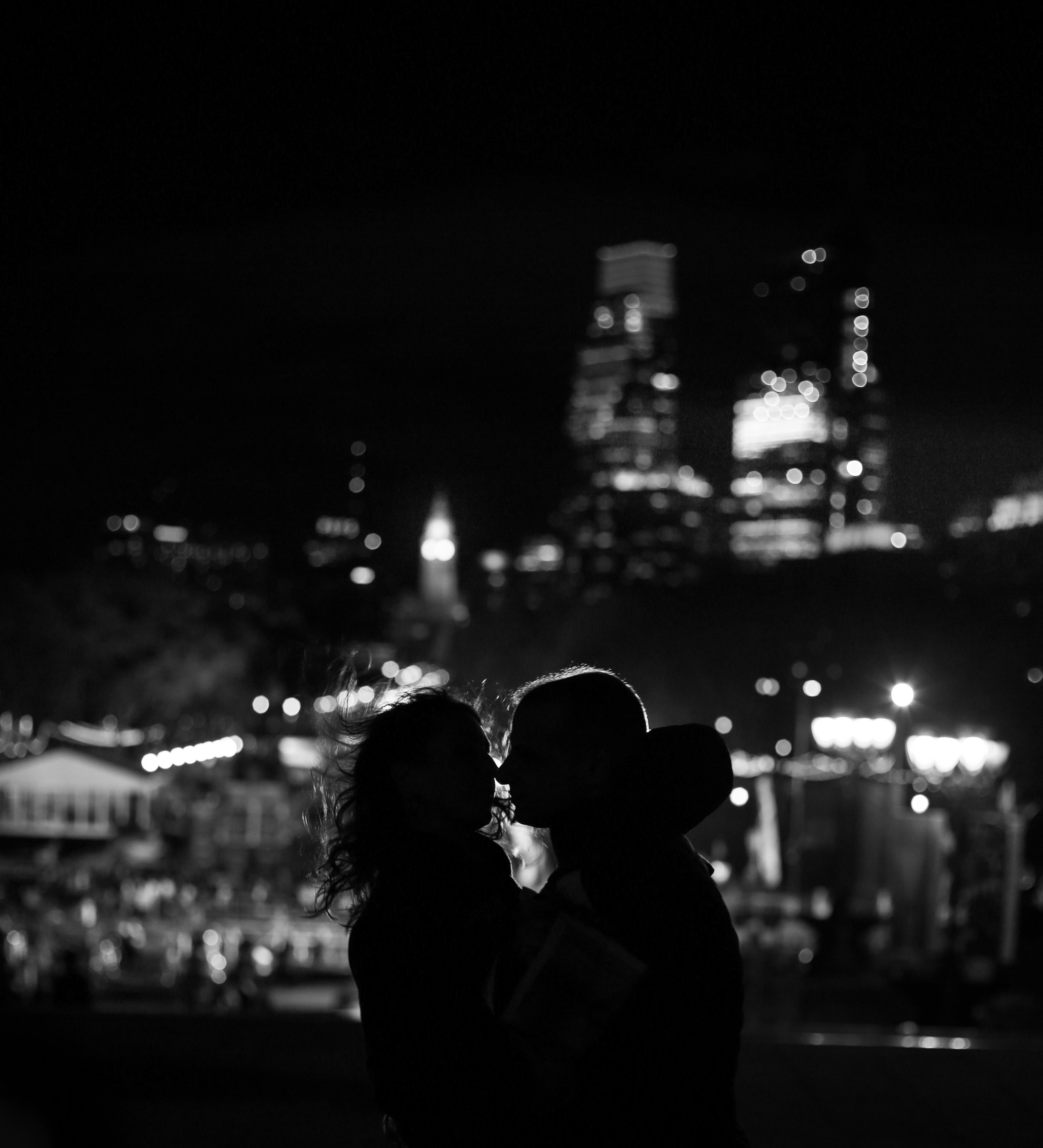 Night philadelphia skyline engagement
