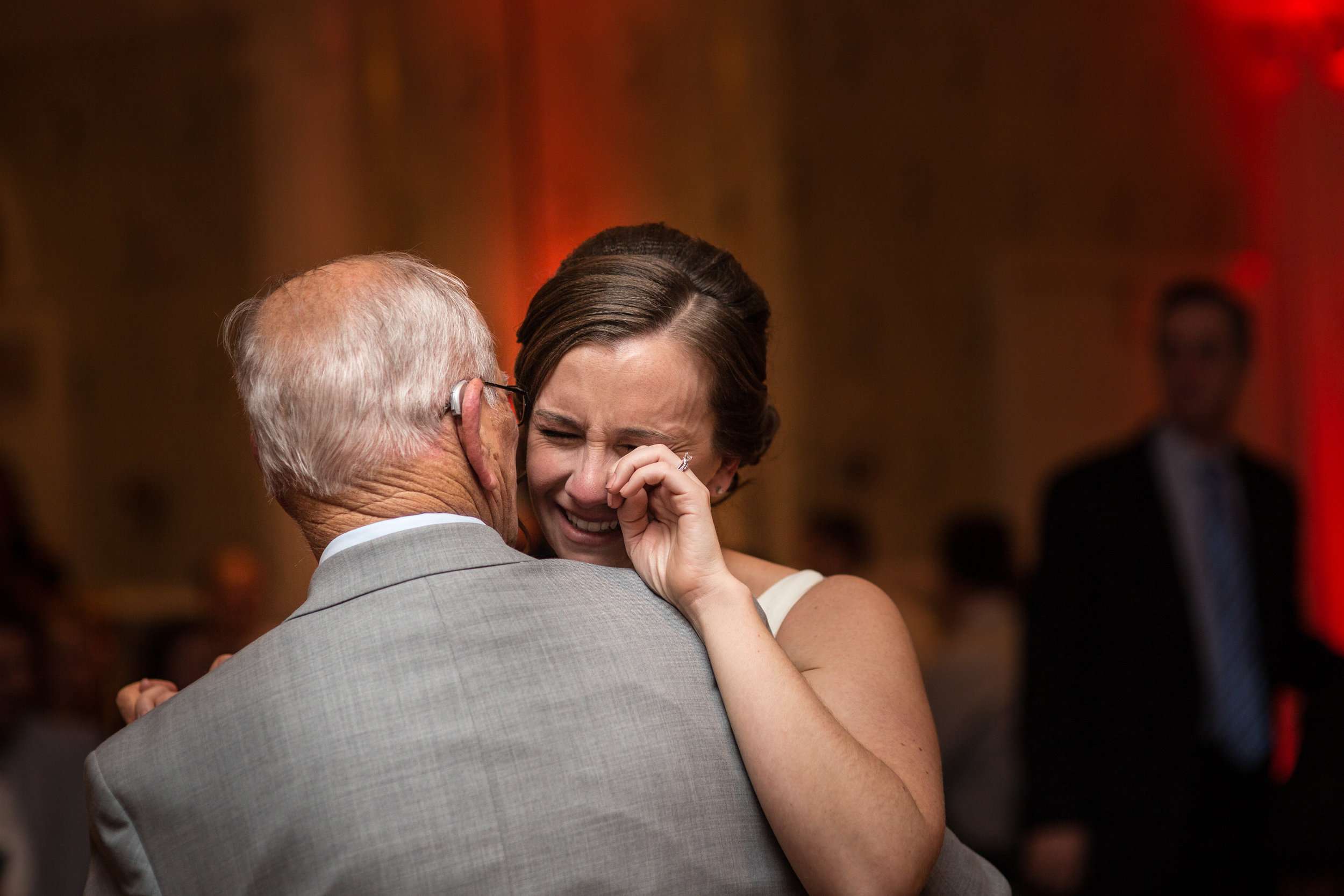 emotional photo of the bride and her grandfather