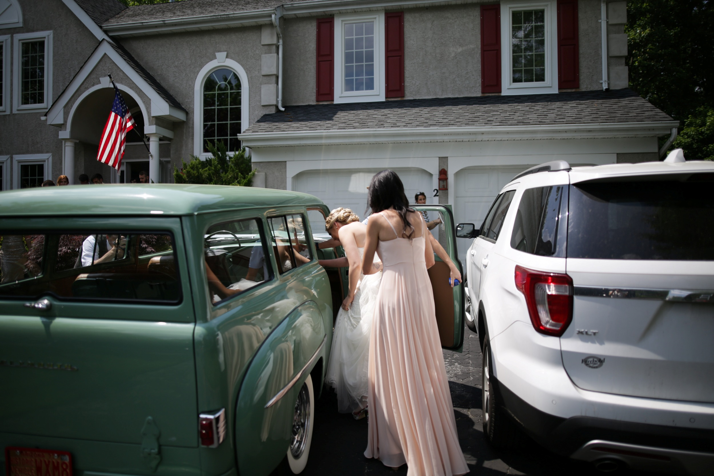 bride getting into antique car
