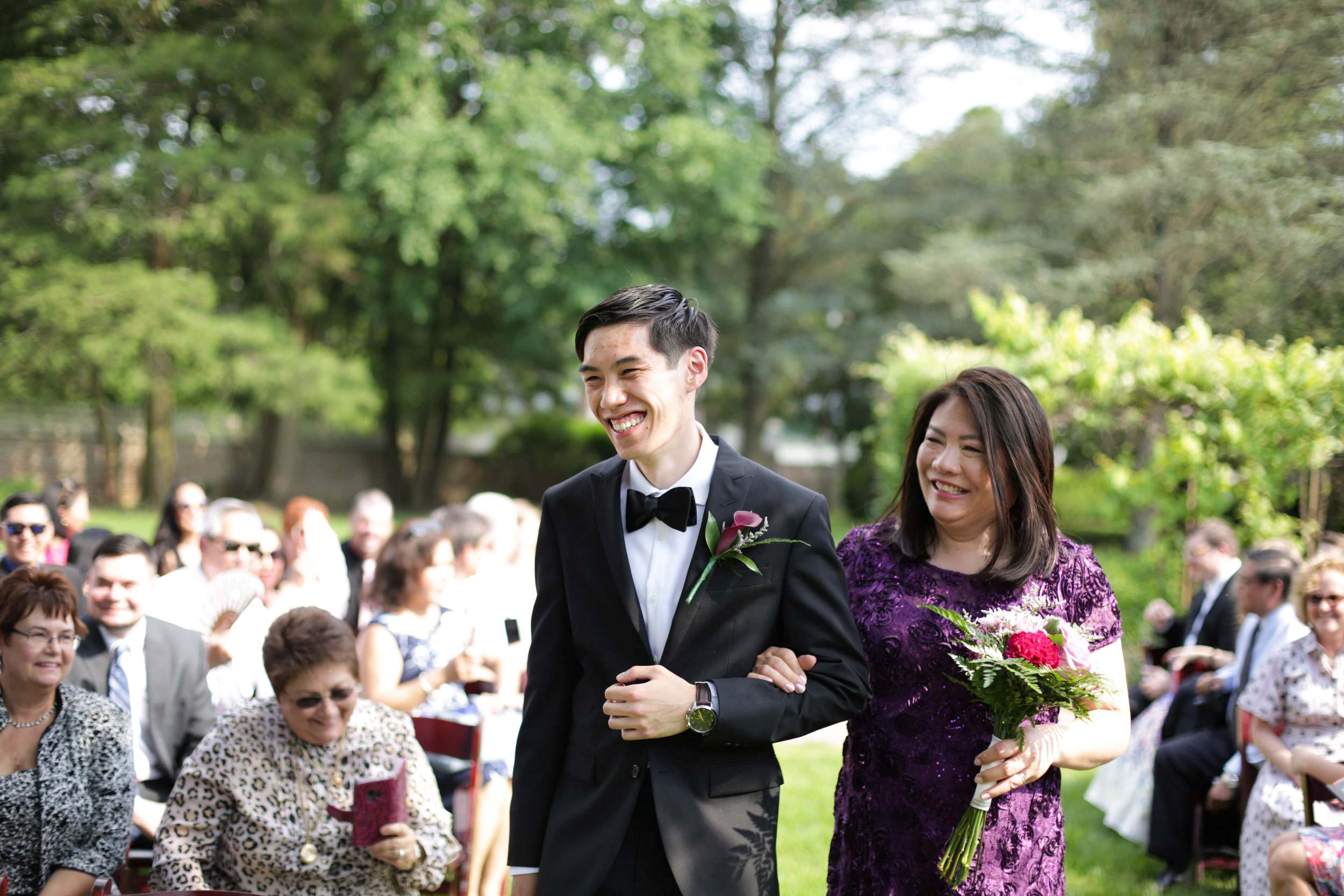groom with mum down the aisle.jpg
