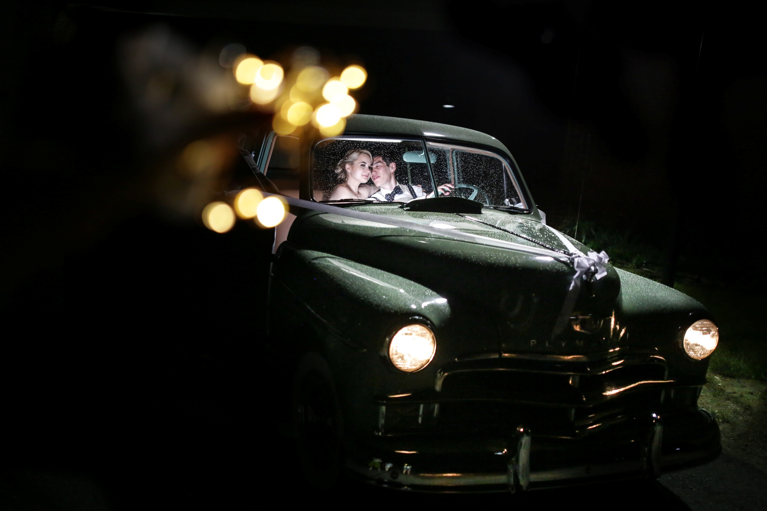 Night creative photo in antique car in Smithville NJ