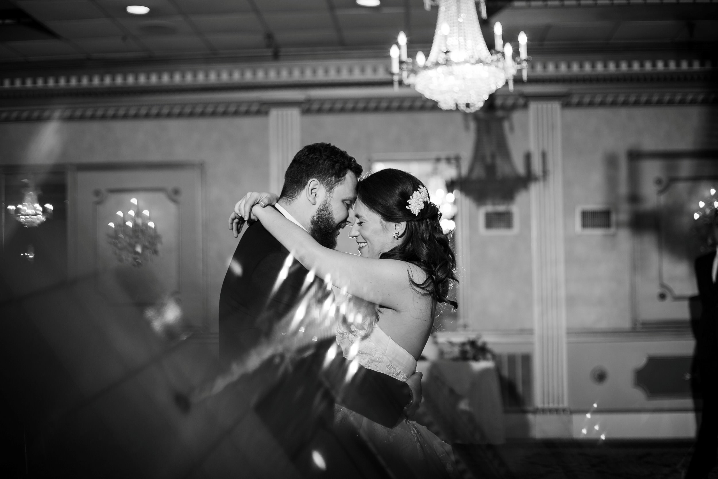 Black and white photos of bride and groom dance