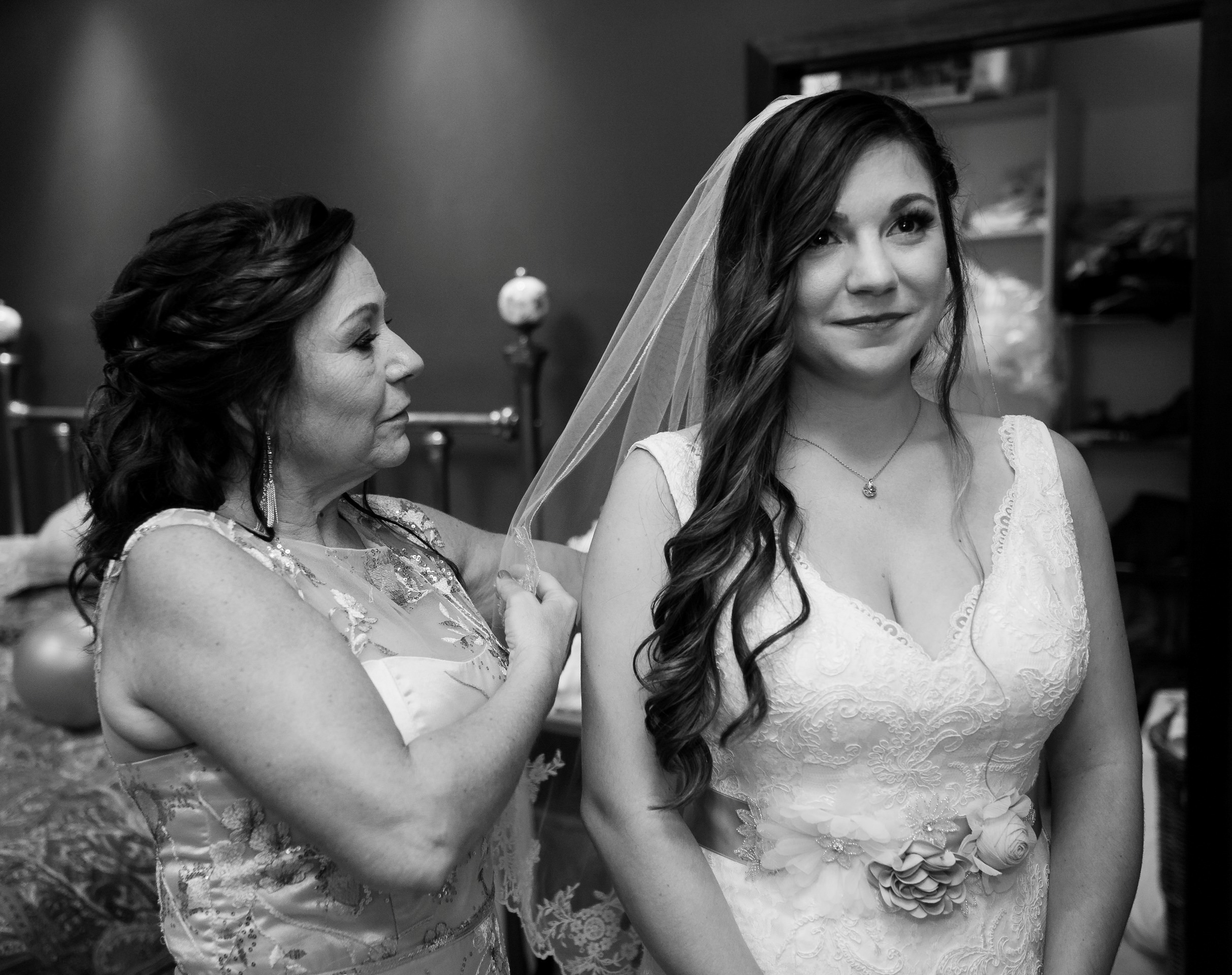 mom helping bride