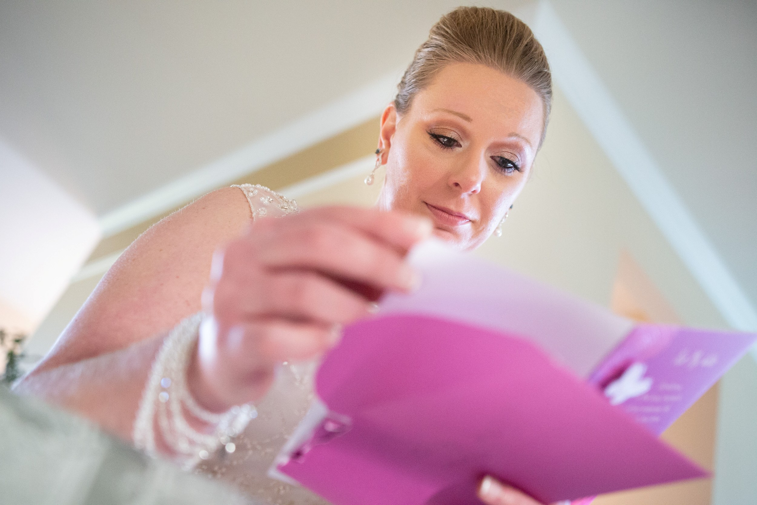 bride reading a note from groom
