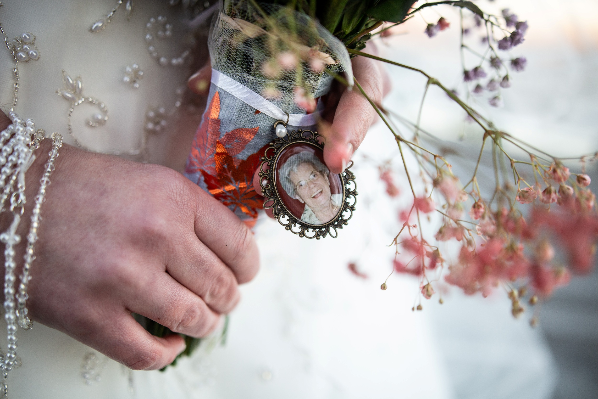 grandmother's charm on bride's flowers