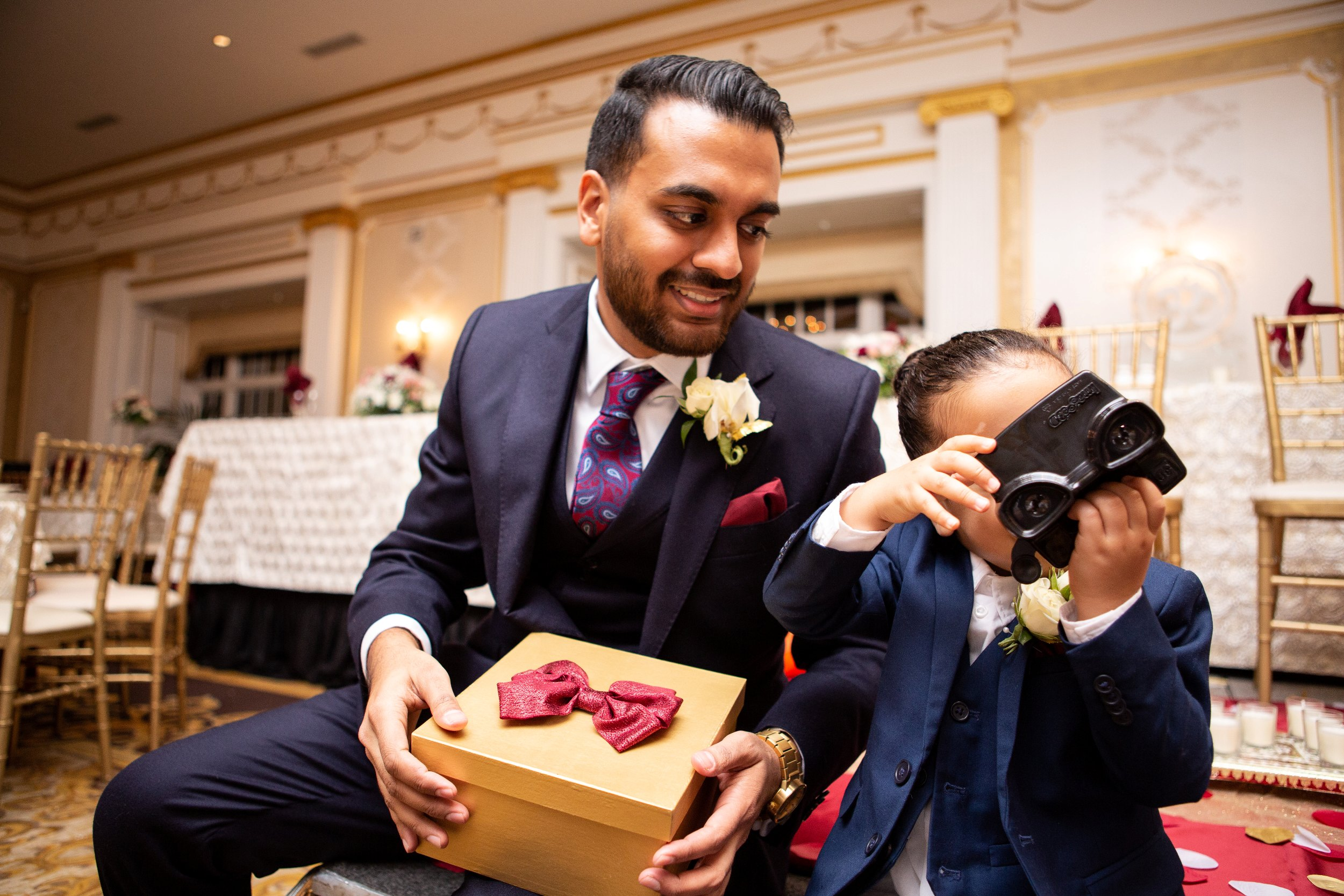 Groom and his son enjoy viewfinder