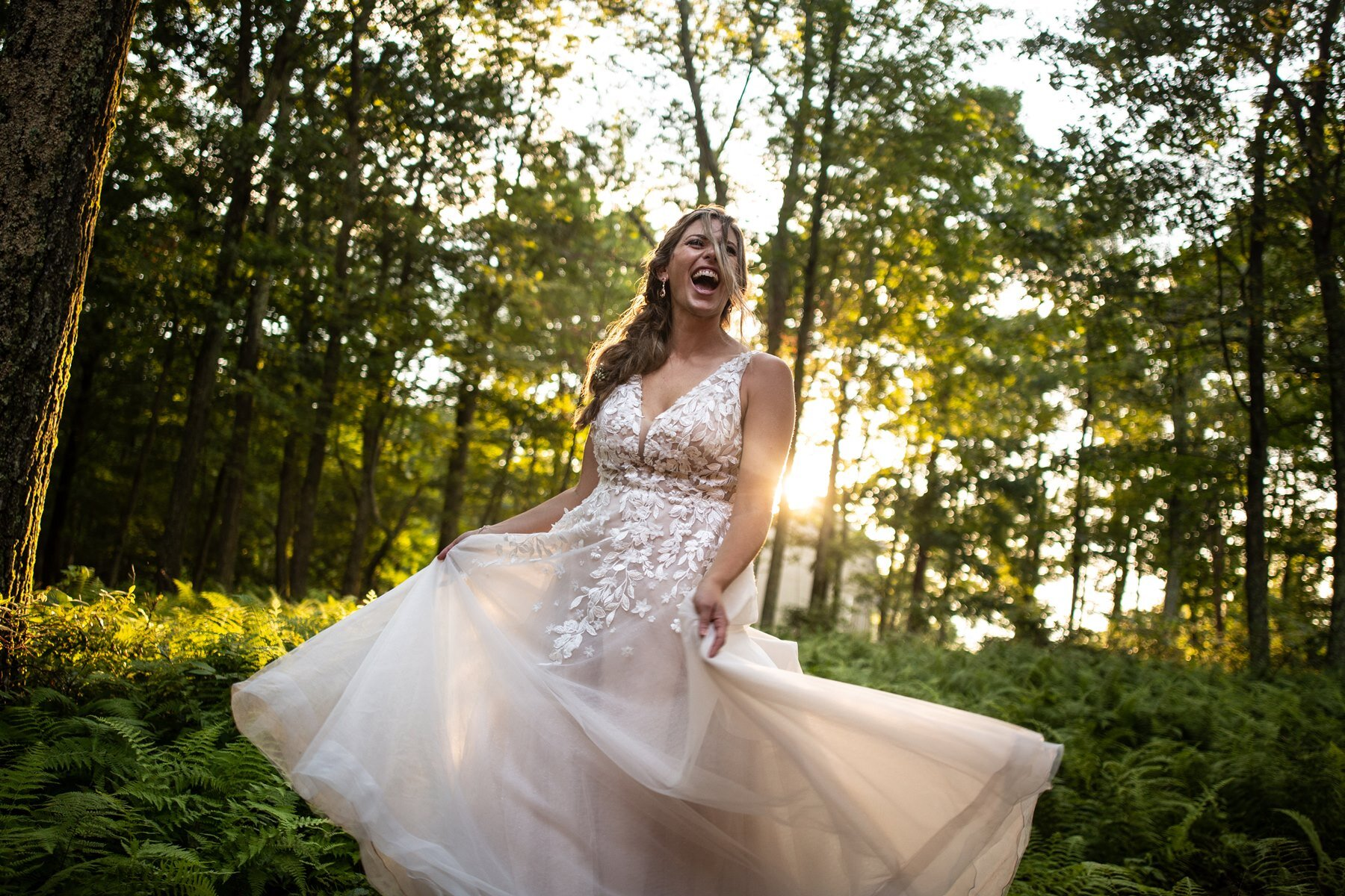 bride twirling at sunset in the mountains