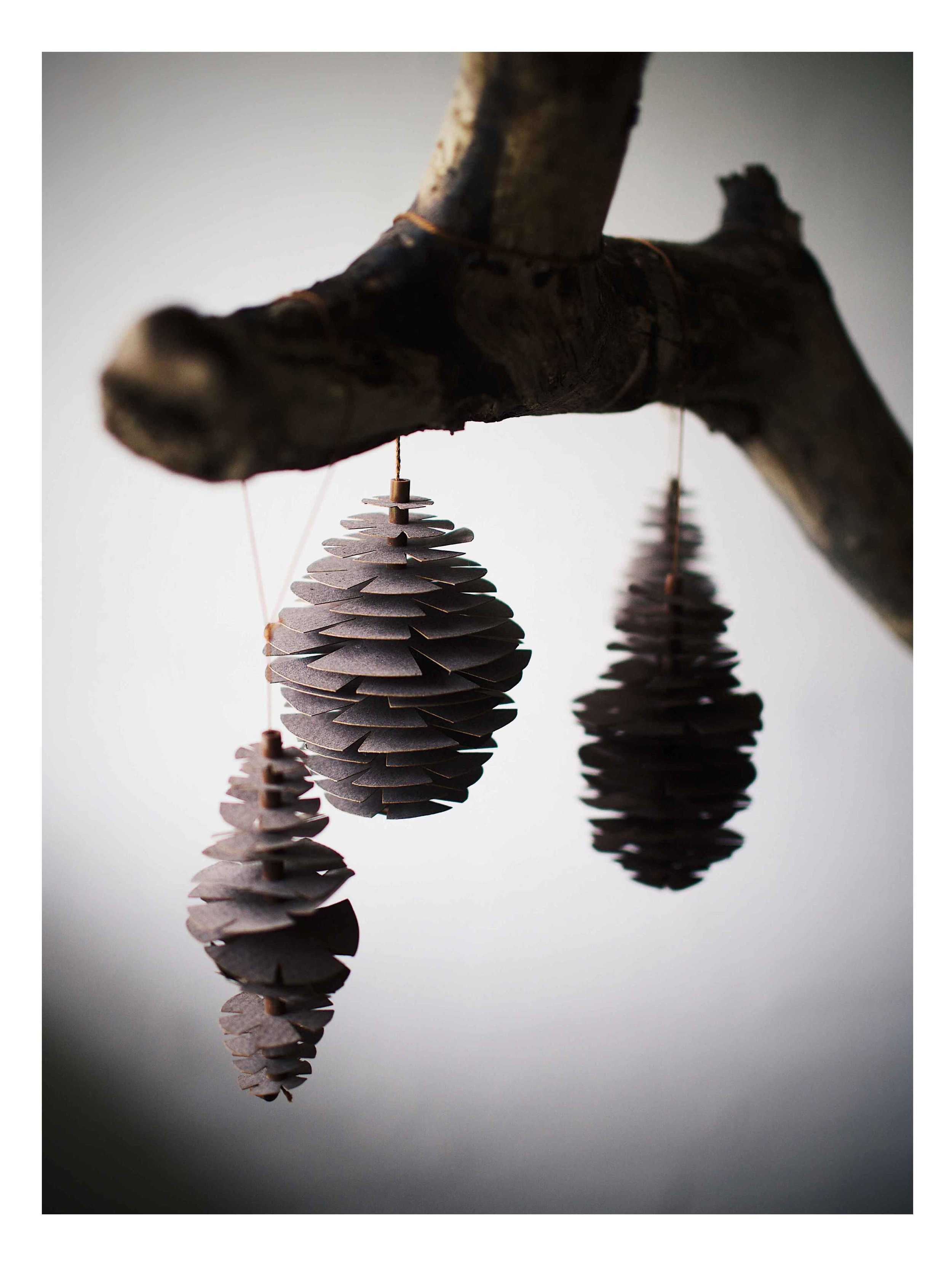 The 3D Winter / Christmas `Nordic Pinecones´ decoration self-assembly kit, comes in a A4 size folder and includes:  Paper arks with ready-to-use elements made of 175 g sturdy paper FSC and ECF certified, 100% natural silk string, beads and simple assembling instruction with illustrations.  Buy at: www.fabgoose.com