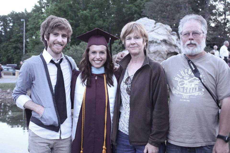 Amie at her graduation with her Master's degree at Southern Illinois University, with her brother and her parents.