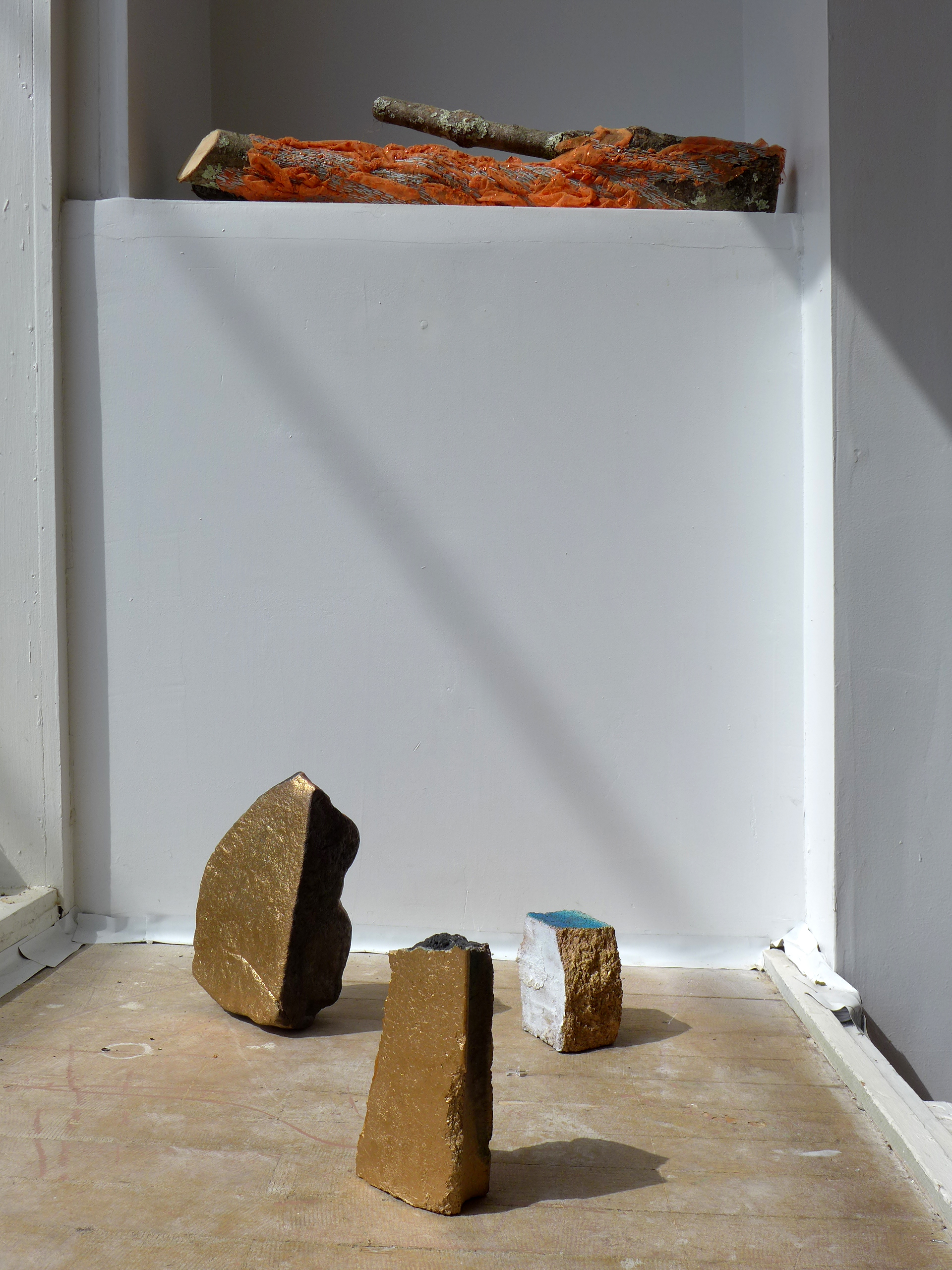 Installation view with American rocks and log by Elana Herzog