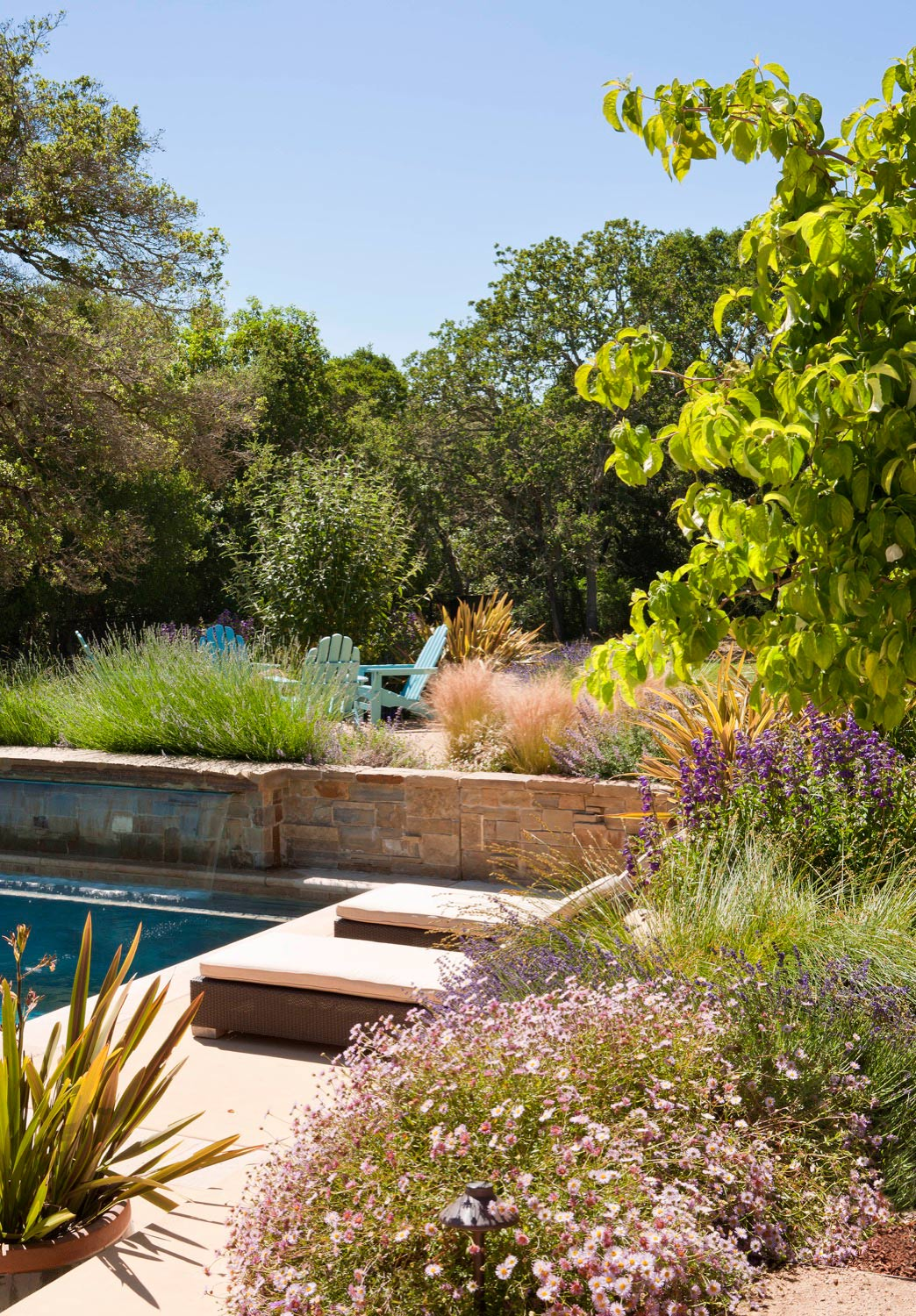 A fountain spills into the pool, creating a subtle and relaxing sound.