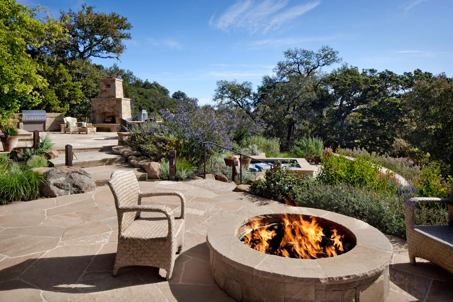 The firepit, spa and fireplace anchor seperate, but closeby, gathering areas.