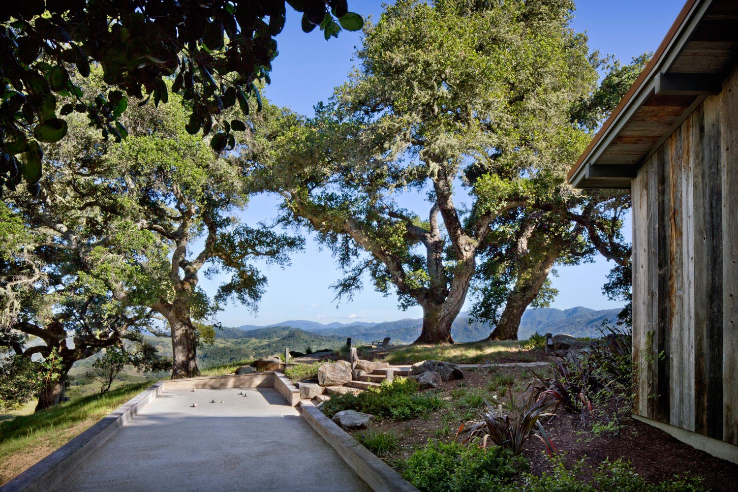 The bocce court is by the guest house and is surrounded by oaks.
