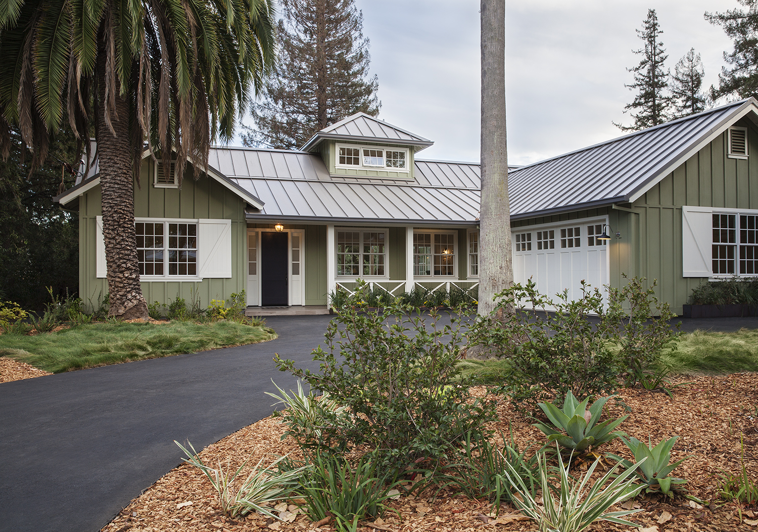 The contemporary agrarian architecture is welcoming from the front drive.
