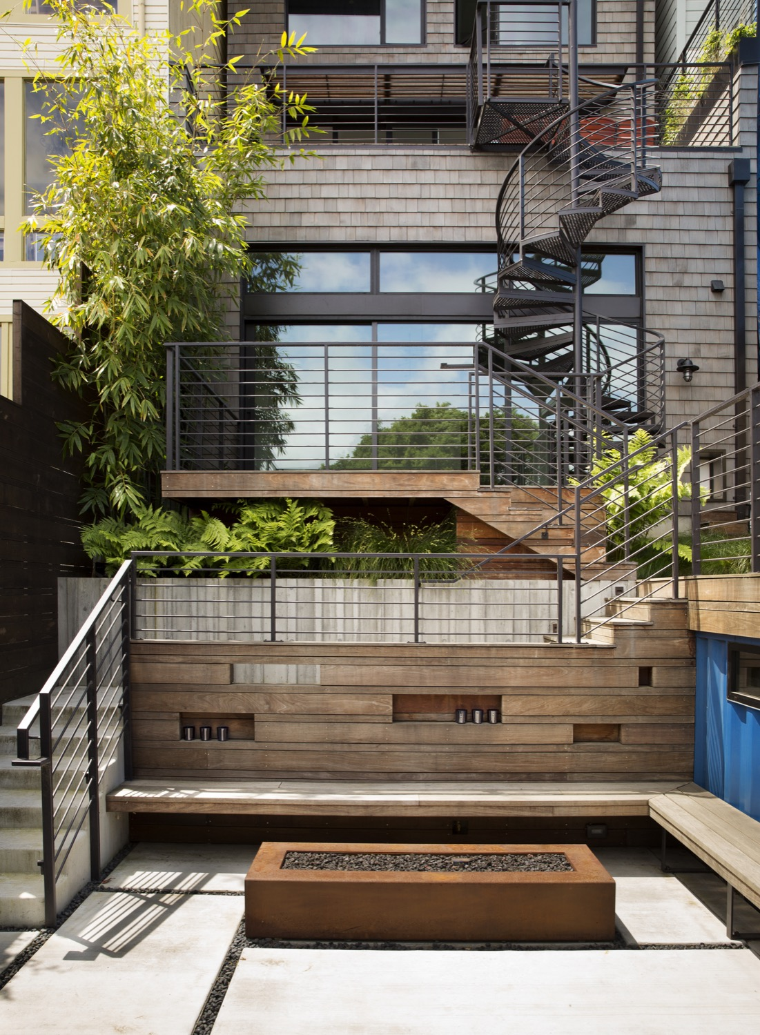 Decks connect on four levels of the building to provide an easy way for the family to access their backyard from a tall, narrow home.