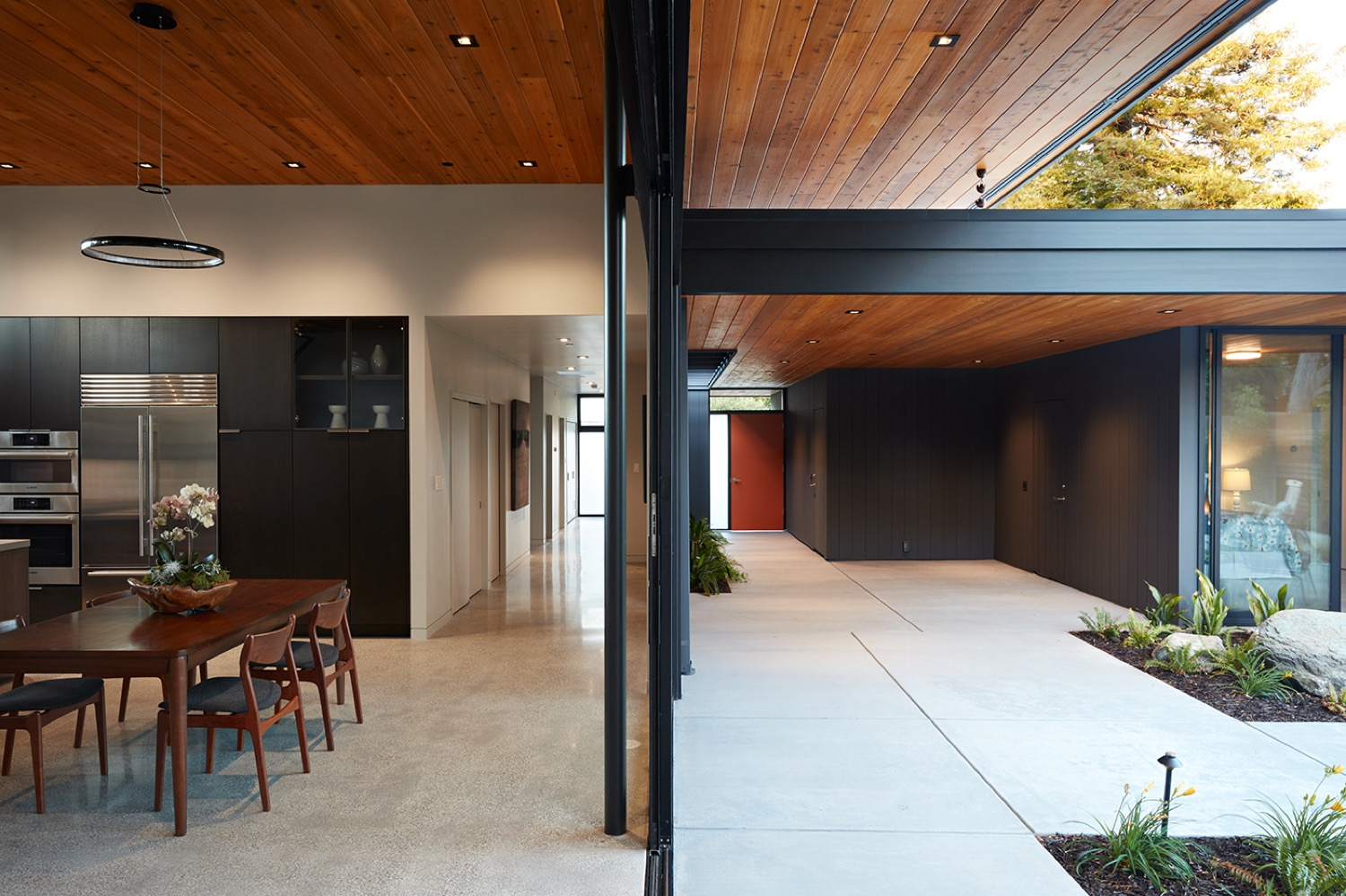 One enters through the front door directly into the courtyard, underneath a large eave in case of inclement weather.