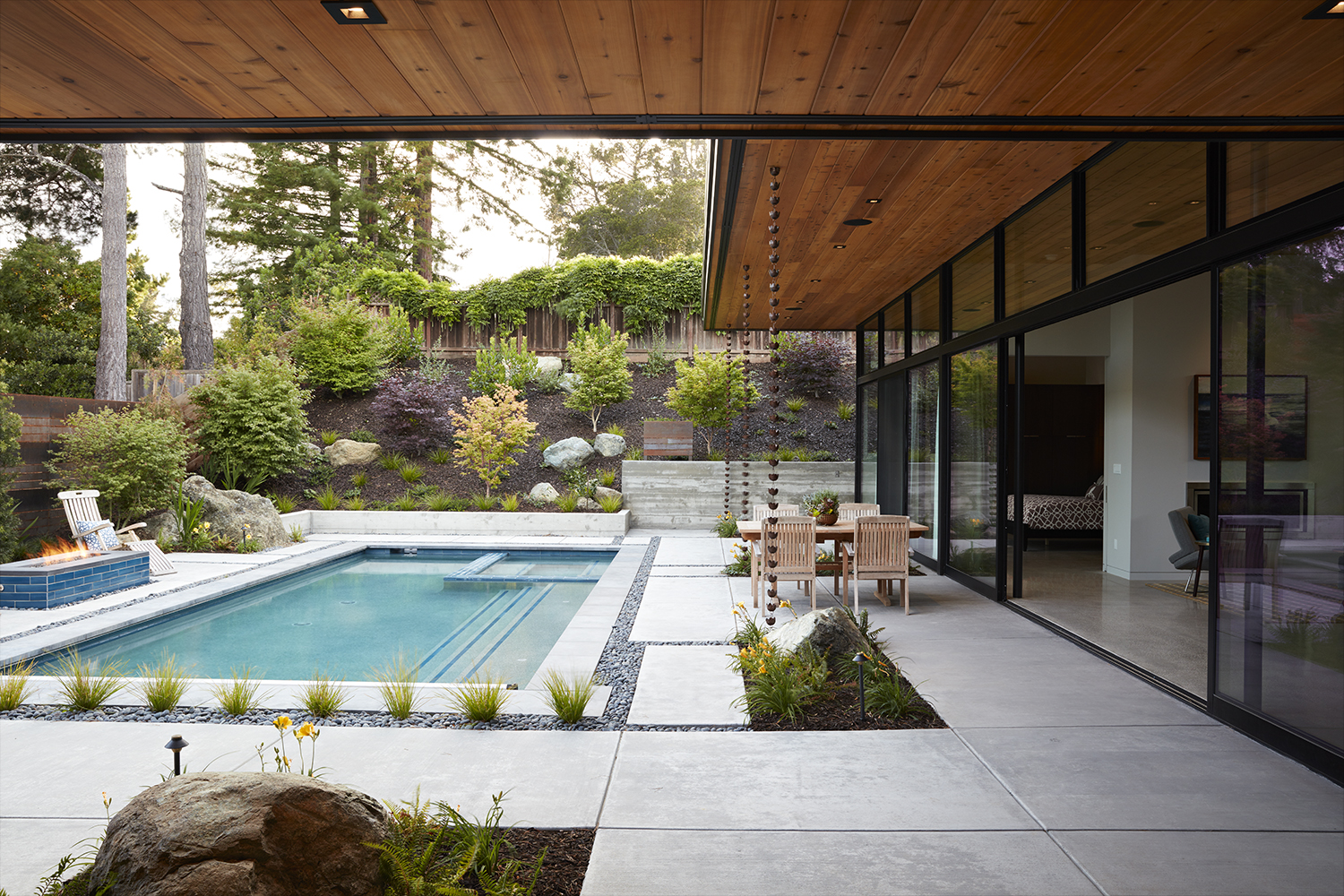 The courtyard houses the pool, firepit and outdoor dining.