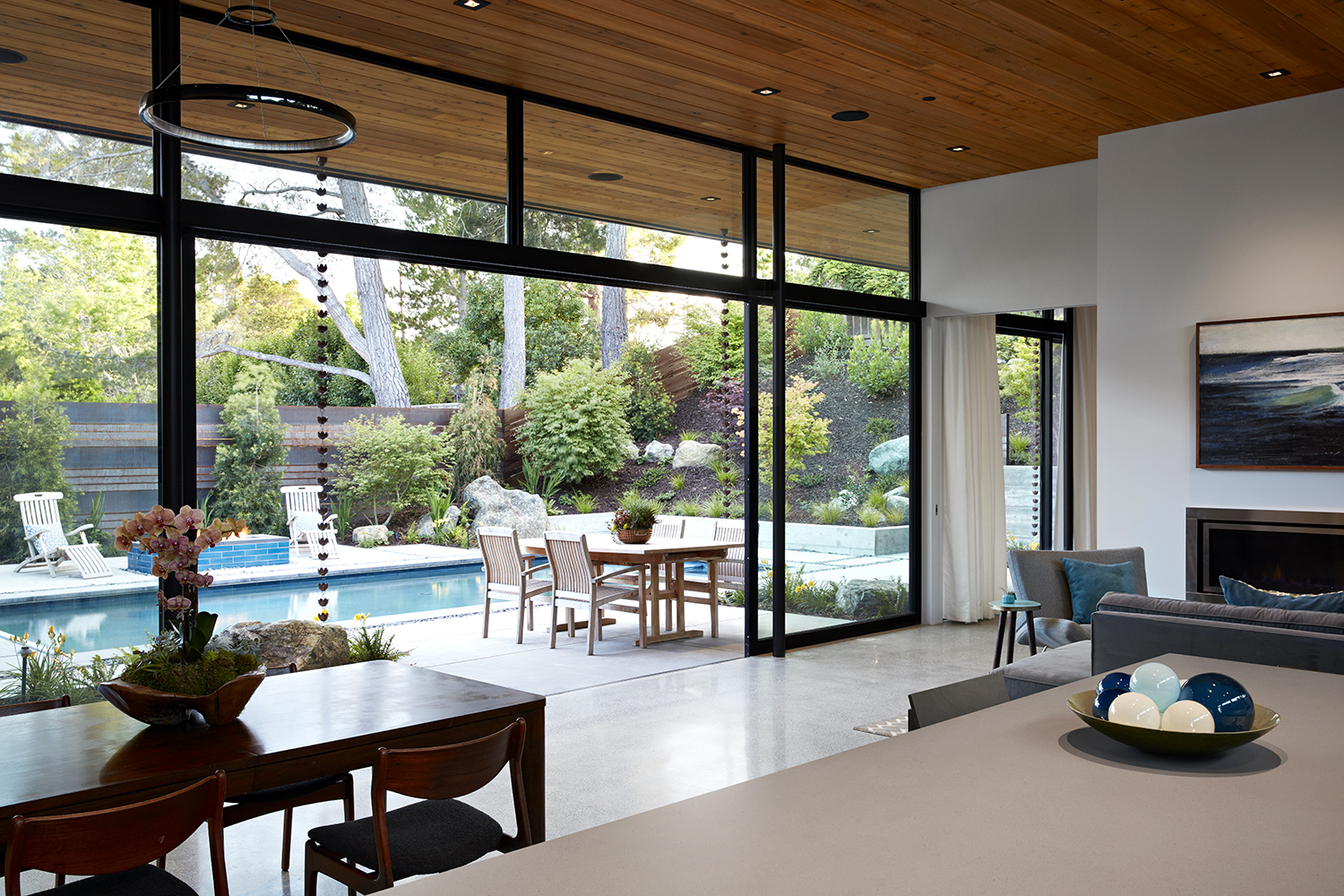 The floor to ceiling glass wall slides open for an uninterrupted connection between indoors and out.