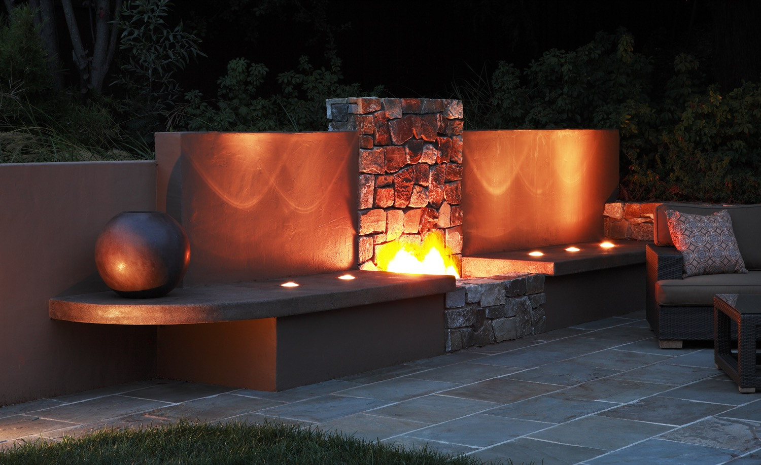 The firepit is bright and warm in the evenings in the outdoor living room.