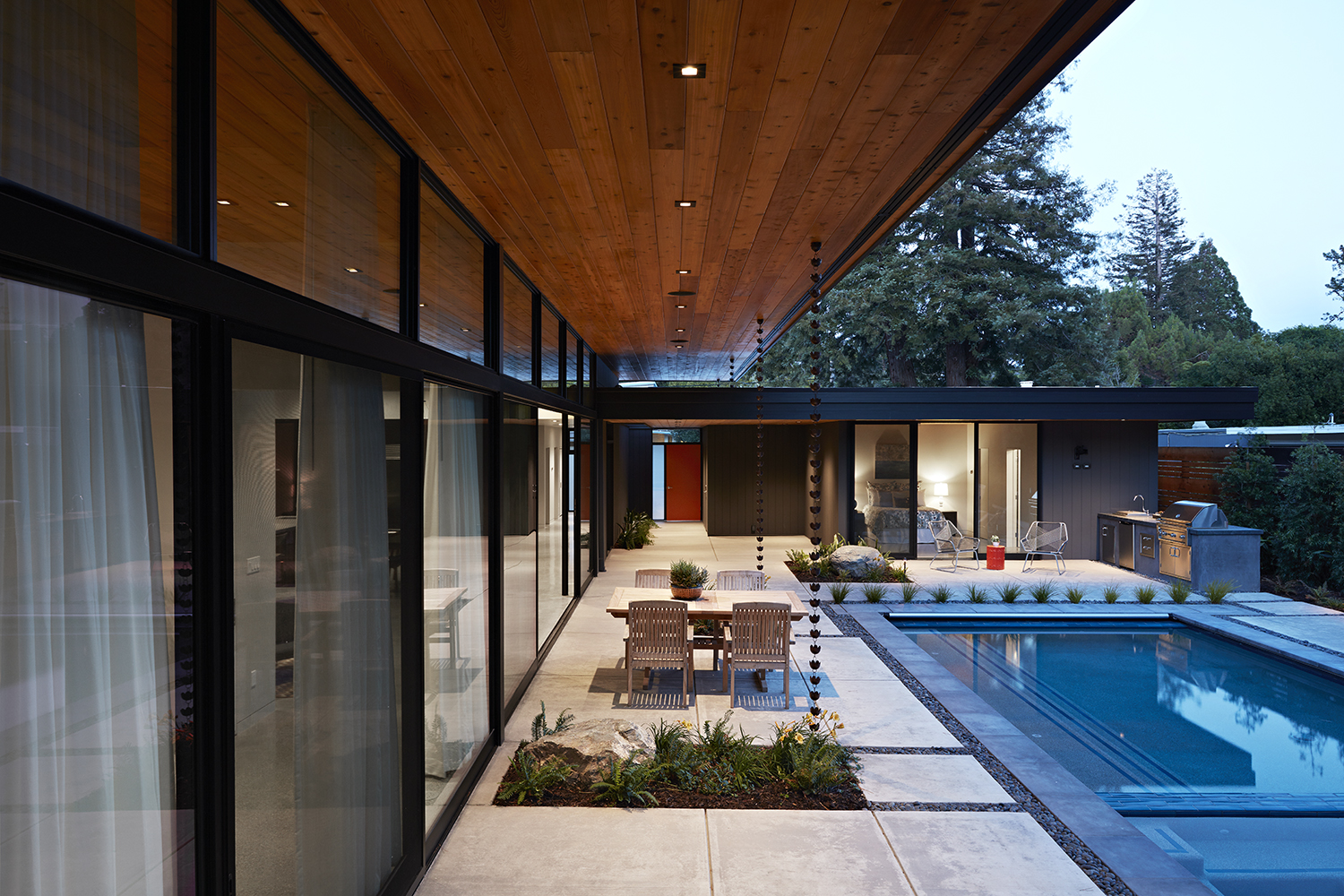 The large overhang provides shade and rain protection for the outdoor dining area.