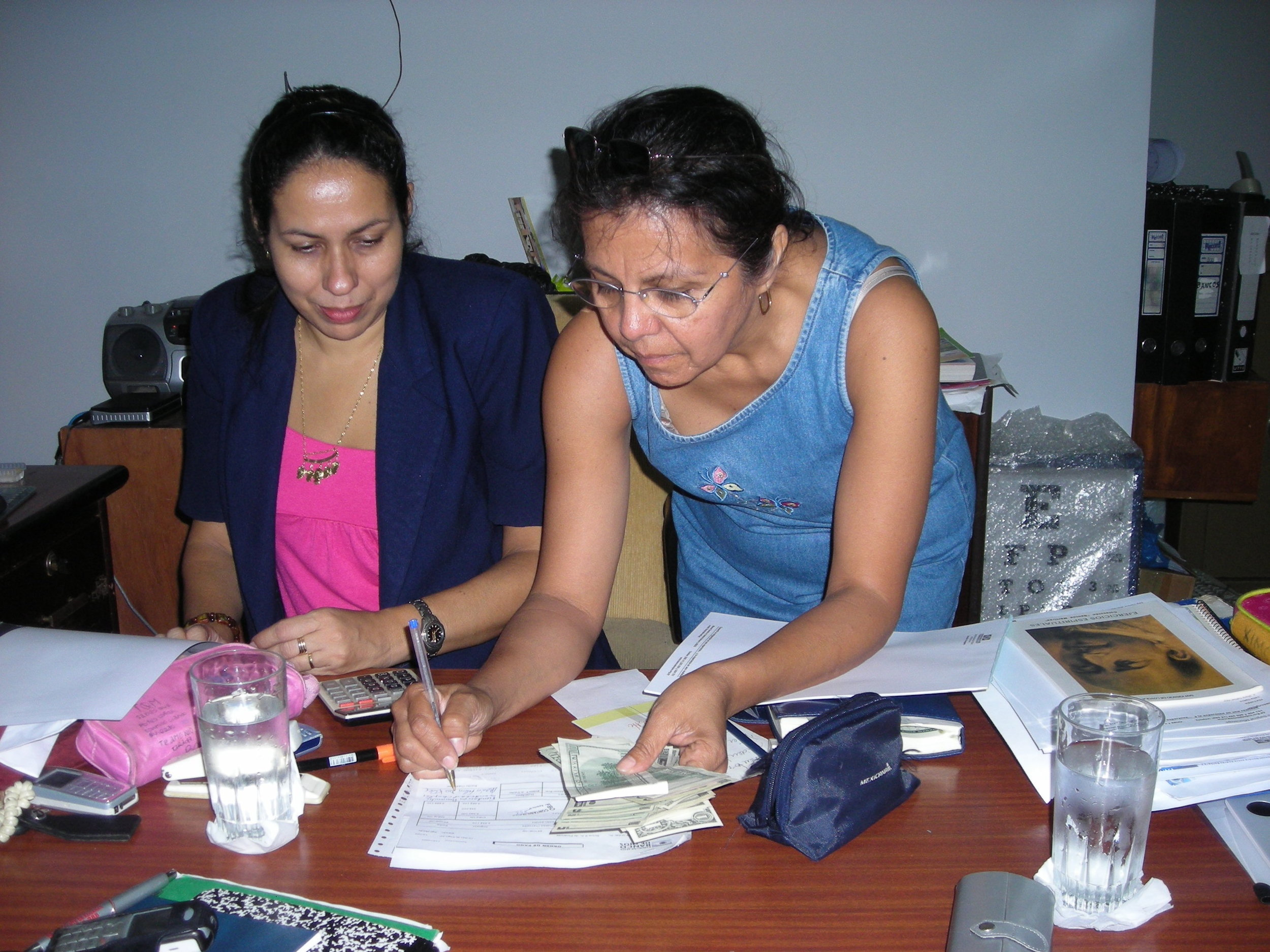 "Mrs. Marta Ruiz administrator at Fernando ""Oca del Valle"" finalizing the arrangements with Mrs. Felisa De Kler"