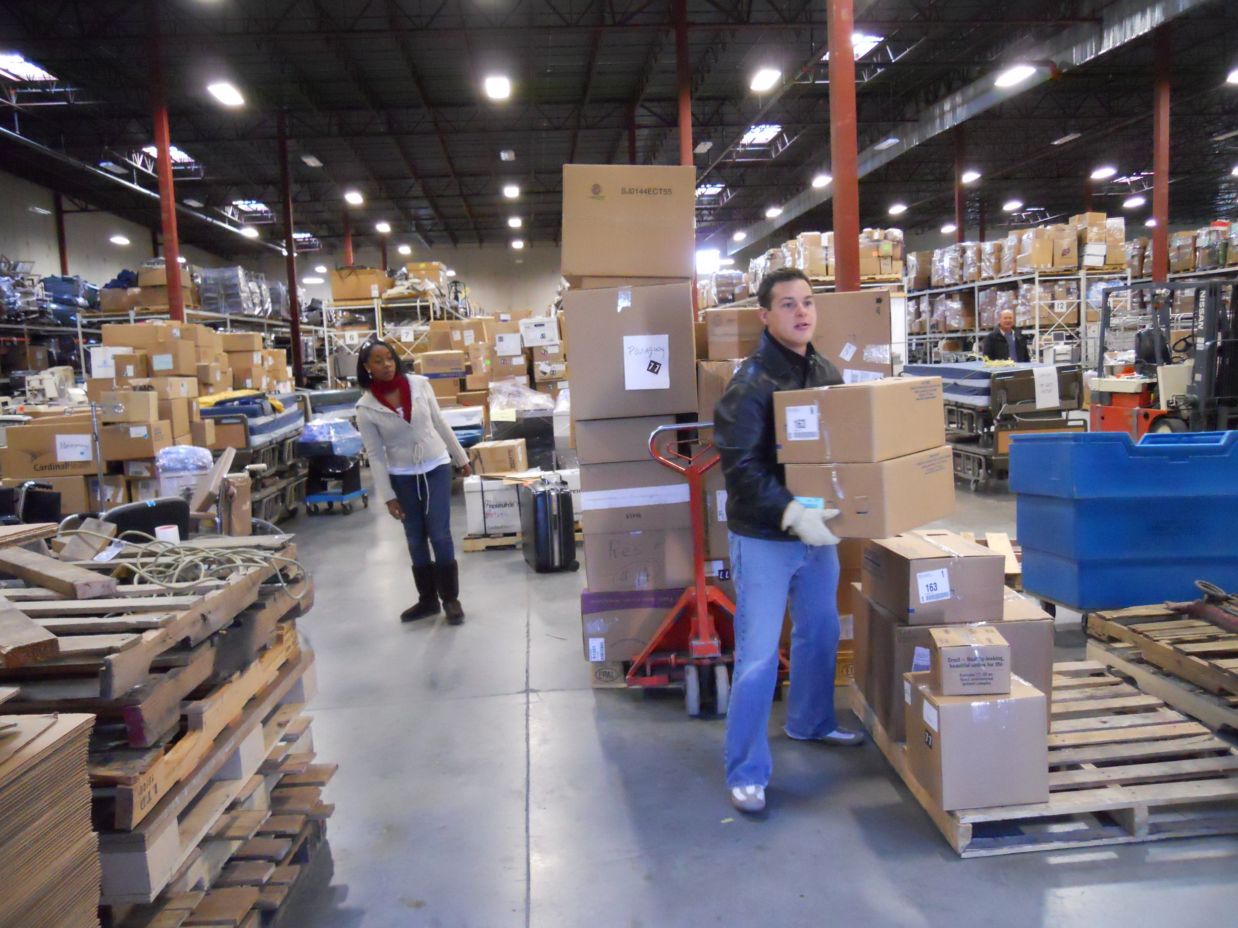 Project C.U.R.E. volunteers in the warehouse