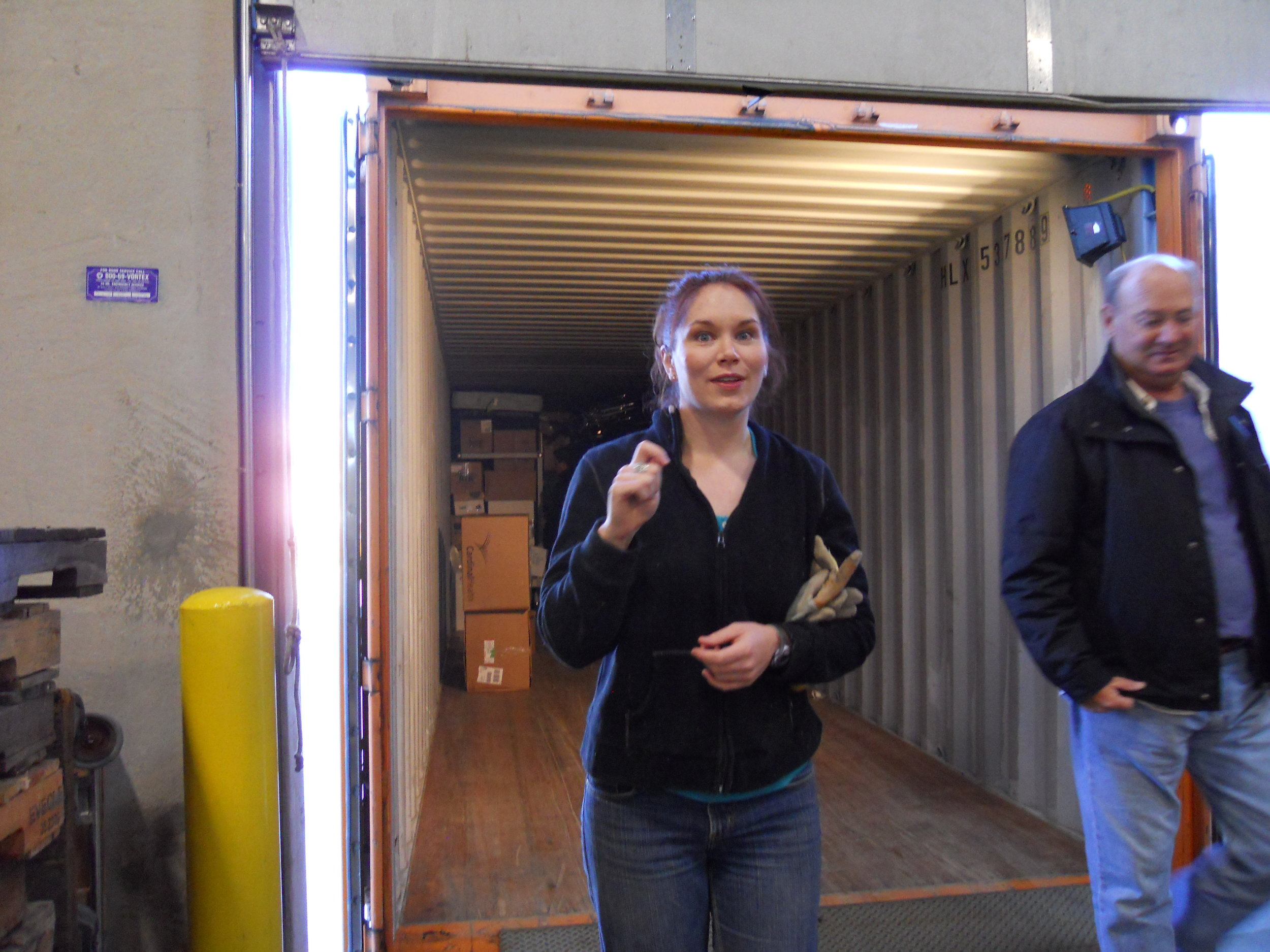 Allison Carey directs the loading of the container.
