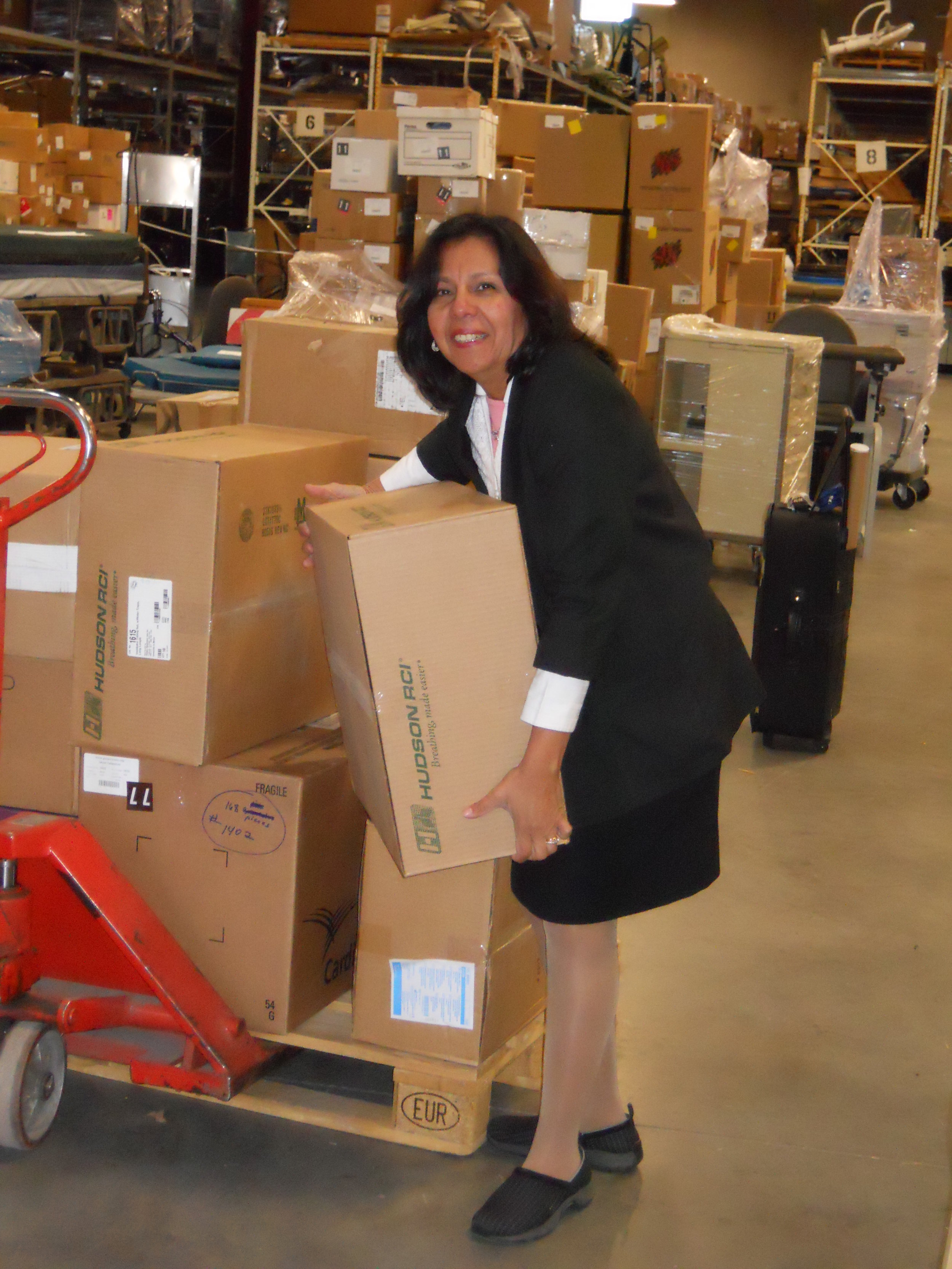 Felisa helping to load the container