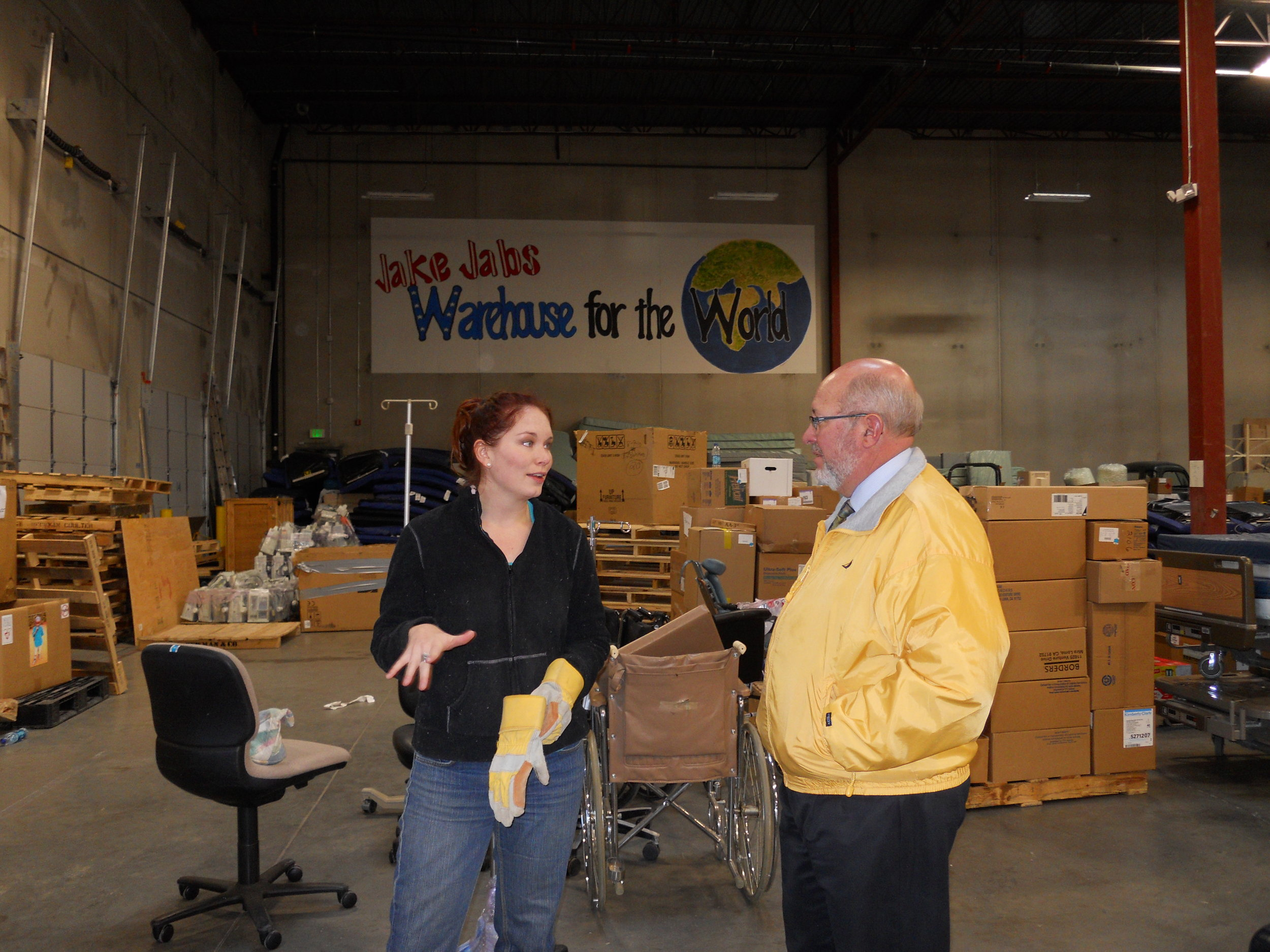 Allison Carey and Gary De Kler discussing Project C.U.R.E. operations