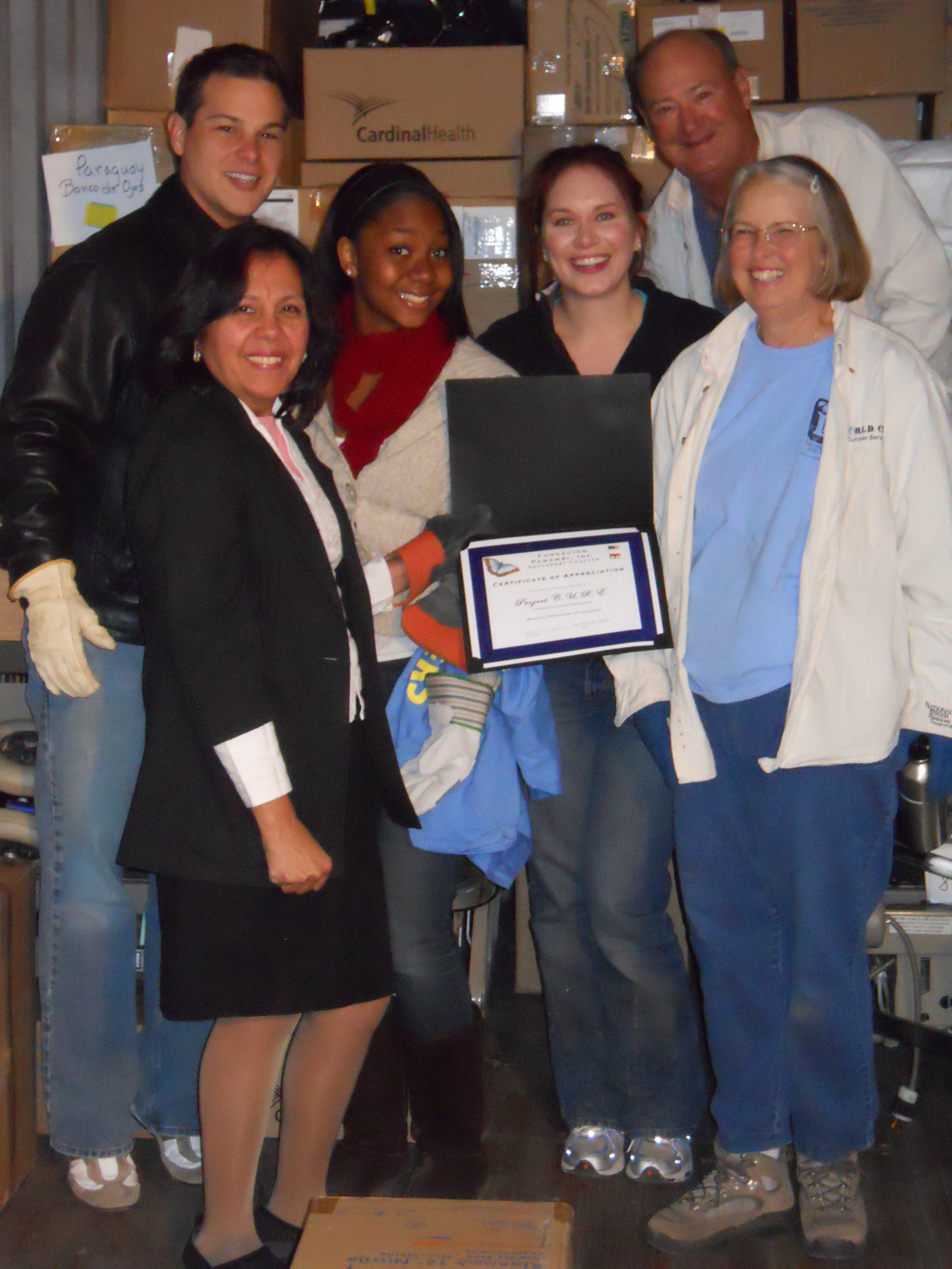 Felisa presenting Certificate of Appreciation to the Project C.U.R.E. staff and volunteers.