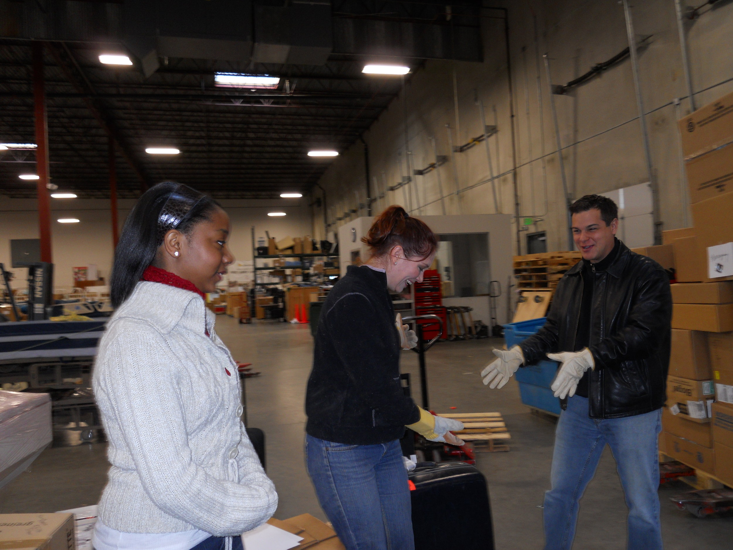Project C.U.R.E. staff and volunteers organizing the loading process